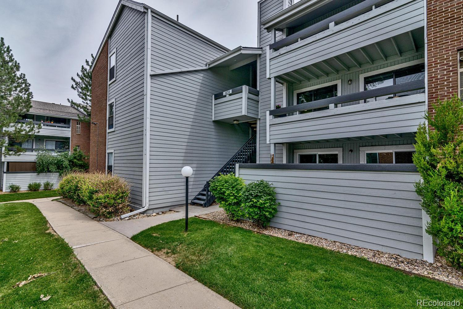 This Unit is located on the second floor and features two bedrooms and two full bathrooms. The kitchen, has been updated with new cabinets, countertops, and flooring. Newer carpet and paint through-out. The living room has a beautiful fireplace with updated tile, large dining area. The laundry room is large and has updated tile flooring. The bathrooms have been updated with flooring and vanities. The balcony looks over the open area with a new private view.  The location is walking distance to shopping and dining, and public transportation. There is one assigned covered parking space with plenty of parking.