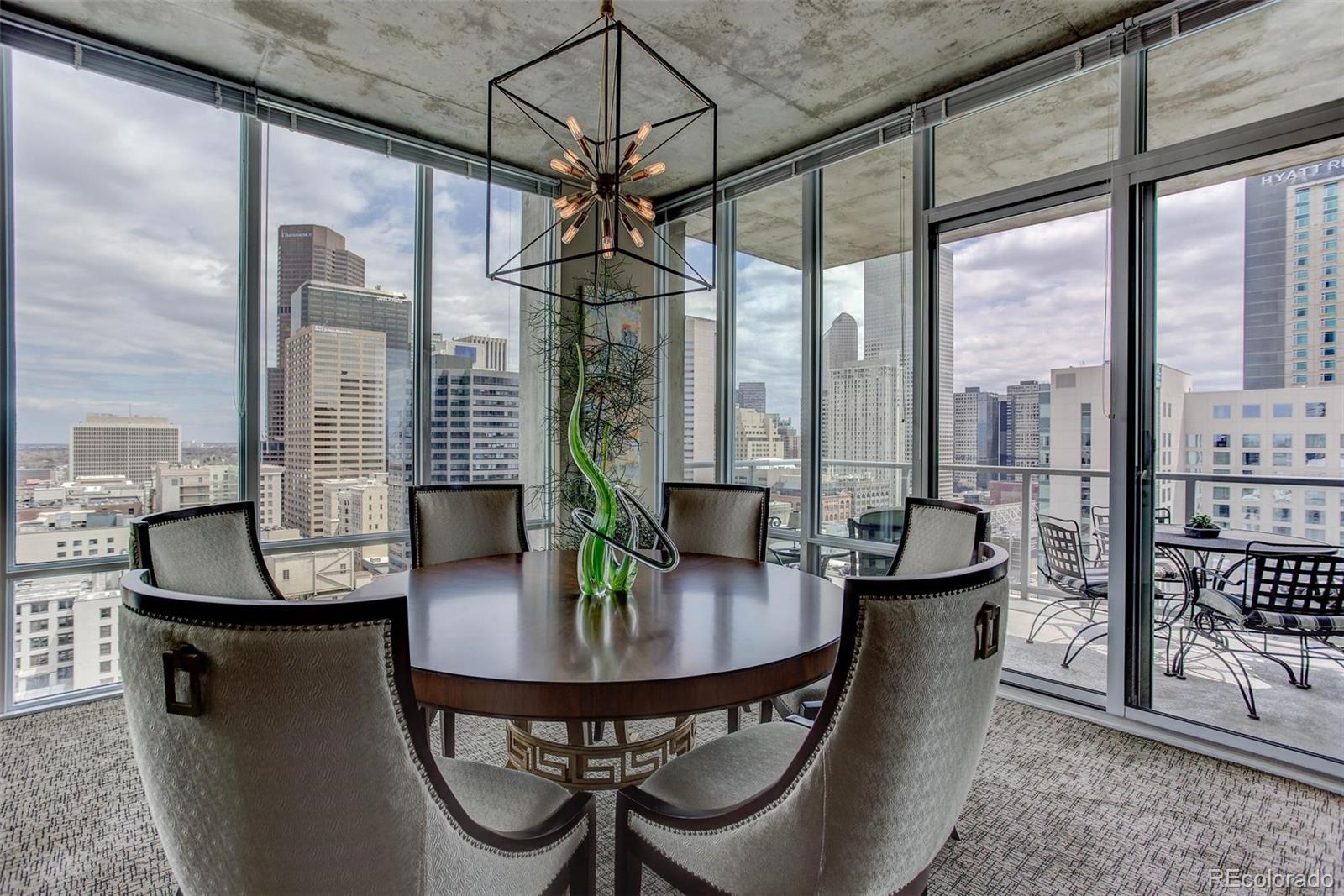 NO HOA DUES FOR A YEAR!! JAW-DROPPING DOWNTOWN VIEWS IN A CORNER HOME! This spacious 2-bedrooms/2.5-bathroom SPIRE condo has nearly 1,700 square feet of living space in a wide-open floor plan with floor-to-ceiling glass and lots of natural light. The oversized balcony will have you feeling like you are suspended in midair! This home offers plenty of privacy with 2 bedrooms on opposite ends of the home, each with a dedicated full bathroom. Cook's kitchen with slab granite countertops, stainless steel appliances, tons of workspace and cabinets galore! Retreat to the master suite with incredible views, a 5-piece master bathroom with frameless shower and dual sinks, and a walk-in master closet with beautiful custom cabinets. The guest bedroom maximizes space with a built-in desk and a murphy bed, all crafted from warm woods. Also included: 1 parking space & two storage spaces in the attached garage. 2nd parking available for purchase. The 42-story SPIRE, with its legendary views, is LEED-certified, with 40,000 square feet of awesome amenities, including a rooftop pool which is heated & open year-round, hot-tub, extensive health club, The Zone multimedia lounge, the Box Office multimedia theater, garage dog park, outdoor grilling area, 10th floor private event lounge, 24-hour courtesy desk, fully-furnished SPIRE guest suites, electric vehicle chargers, and modern access control systems. SPIRE has great internet service now and super-fast service coming soon--1 gig dedicated to each condo. SPIRE is in the heart of it all. Conveniently located at 14th Street & Champa Street, you can stroll or grab the free shuttle to Larimer Street restaurants, downtown's night life, the Colorado Convention Center, Denver Center for the Performing Arts, Denver Pavilions, Whole Foods Market, the emergent Union Station neighborhood and the A-Line train to Denver International Airport.  Come home to Downtown Denver's SPIRE -- life is better here!  Available for a quick closing.