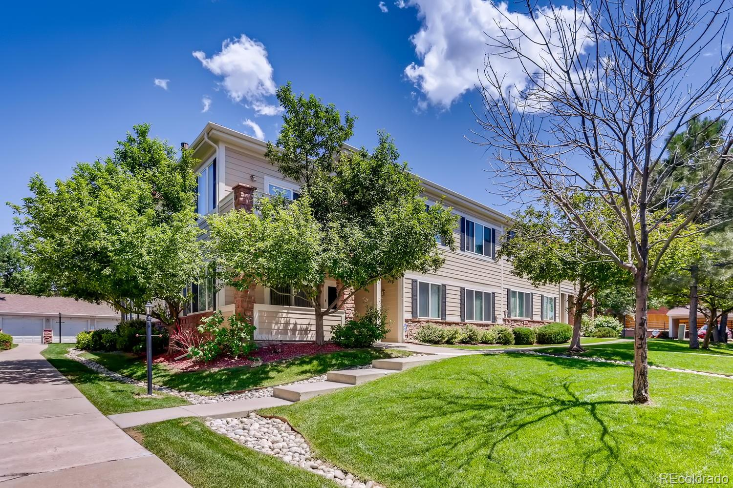 Oh how sweet it is, is this charming 2 bedroom, 2 bath condo in Silver Ridge. These homes don't come up often and it's certain not to last long! You won't be disappointed with the 1120 square feet of space that offers up open concept living, the cutest 2 sided fireplace there ever was and tile floors throughout the main living areas. The kitchen with it's beautiful wood-look tile even has a *brand new refrigerator*.  Down the hall you'll pass the laundry area which *includes* the washer and dryer, the secondary bedroom with *BRAND NEW CARPET* and a full bath.  Just on the other side of that is the spacious primary bedroom which also has *BRAND NEW CARPET* a walk-in closet, linen closet and a large full bath.  If that's not enough, there is also a detached one-car garage and a dedicated parking space for the unit.  No windows face parking lots so you can enjoy the green views from your living room, the covered porch and bedrooms during our gorgeous Colorado Summers. When the air turns chilly, snuggle up with the fireplace and watch the snow fall. This is truly a fantastic home and ready for someone to move in and make it their own.  Please note, this complex is not currently approved for FHA-VA to the best of our knowledge.