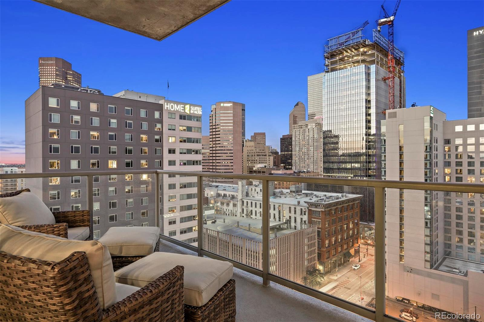 """POPULAR CORNER TREMONT FLOOR-PLAN AT ATTRACTIVE PRICE - BEST PRICE OF ANY """"09"""" UNIT & INCLUDES 2 PARKING SPACES! Enjoy the View of Downtown Denver's City Skyline from this Gorgeous Light-Filled Space.  The East Facing Balcony Allows You to Take In the Morning Sun and Relax in Comfort in the Evenings. New Paint Throughout! Beautifully Maintained with Newer Improvements within the last 3-5 yrs to Include: Oak Hardwood Floors Throughout, Updated LED Lighting, Classy Built-In Media Unit at Living Room and Office with Backlit LED Lighting, Kitchler Ceiling Fans, Upgraded Grohe Faucets & Water Saving Toilets, Two New Heat Pumps, Nest Thermostats and Window Treatments with Blackout in Master & Office/Bedroom. The Kitchen Features Newer Granite Counter Tops & Glass Backsplash with Custom Pull-Out Shelving, Updated LED Overhead and Under Cabinet Lighting, New Bosch Induction Stove/Oven, New Miele Dishwasher, Newer Refrigerator. Privately Situated Master Suite with 5 pc Bath & Walk-In Closet. The Office/2nd Bedroom is Versatile for Home Office and Guest Bedroom with Murphy Bed. Ample Closet Space in All Rooms which is Maximized by the Custom Closets & Pull-Out Shelving. Deeded Parking Spaces are Wide & Close to Elevator for Easy Access. Large Storage Unit. LEED Certified Building with Sought After Amenities Include: Roof-Top Heated Year Round Pool, Hot-Tub, Fitness Center, Theater Area, Lounge, Outdoor Grill, Dog Park, Guest Suites, Electric Charging Stations and 24-Hour Concierge Desk. Fast Internet Now with 1-gig Installation Underway to Each Unit!"""