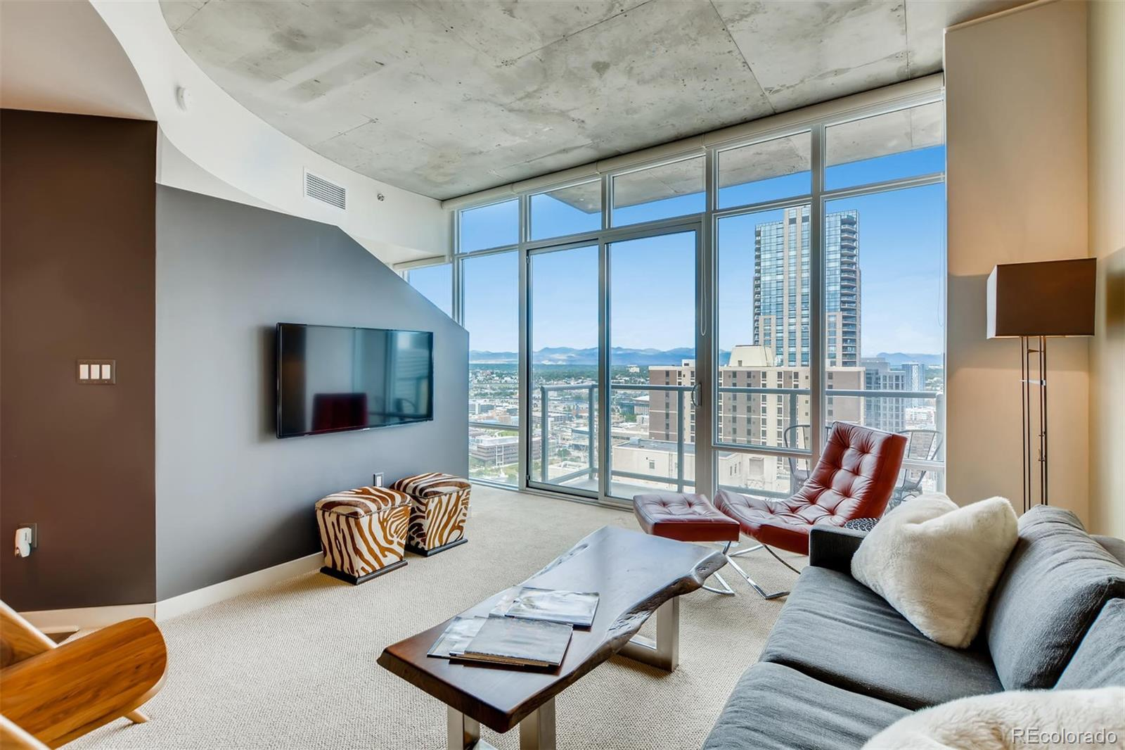 THIS 1-BEDROOM + DEN SPIRE CONDO HAS MIND-BLOWING VIEWS OF DENVER! SPECTACULAR MOUNTAIN VIEWS! AND UNBELIEVABLE CITY VIEWS!! This 30th floor home features dramatic floor-to-ceiling windows, loft-like design, stainless steel appliances, slab granite counters, hardwood floors, newer carpeting, and includes a deeded parking space in the attached garage. Special features include fantastic upgraded lighting, a murphy bed in the den/office, custom closet systems, and lots of storage throughout  Washer/Dryer included. Furnishings are negotiable. SPIRE is LEED-certified, w/40,000 square feet of awesome amenities, including a swimming pool which is heated & open year-round, hot tub, extensive health club, The Zone multimedia lounge, Box Office multimedia theater, outdoor grilling area, 10th floor private event lounge, 24-hour courtesy desk, furnished SPIRE guest suites, modern security & access control systems, and so much more. SPIRE Denver has fast internet coming soon-1 gig dedicated to each condo. Fastest downtown! Very well-maintained building! SPIRE is in the heart of it all. Conveniently located at 14th Street & Champa Street, you can walk or grab the free shuttle to Larimer Street restaurants, downtown's night life, the Colorado Convention Center, Denver Center for the Performing Arts, Denver Pavilions, Coors Field, Whole Foods Market, the emergent Union Station neighborhood and the A-Line train to Denver International Airport. Come home to Downtown Denver's SPIRE -- life is better here!