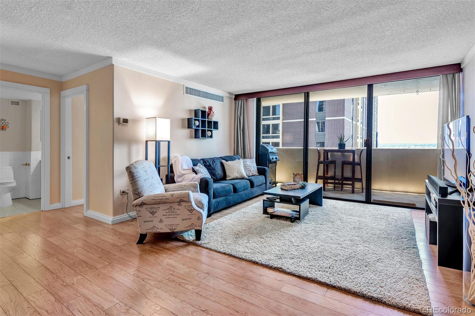 """Chic hideaway in downtown Denver! Just steps from the best that Denver has to offer - walk to the Performing Arts Complex, Historic Larimer Square and the 16th Street Mall - all of Denver is at your feet! Private and very quiet, this beautiful condo features gorgeous city and mountain views, and has been completely updated with sleek, high end finishes.  Featuring a custom, craftsman style wood kitchen with sleek quartz counters, stainless steel sink, backsplash and appliances (incl. wine fridge), clever storage behind soft close drawers and doors, and a large walk in pantry - the custom kitchen extends to create a comfortable dining space with bar seating for 4 and plenty of built in storage. The sunny living room sits easily between the kitchen and the private patio, where you can dine al fresco while enjoying gorgeous Colorado sunsets night after night, with west facing mountain views that include Mt. Evans and Red Rocks for the ultimate """"WOW"""" factor!  This chic condo also features two updated tile bathrooms and a Master Ensuite that is private and quiet.  The second bedroom includes a Murphy Bed built in the same craftsman style as the kitchen, and functions well as a combination bedroom/home office. Upgraded flooring, lighting (all on dimmer switches) and plumbing fixtures, and 3 separate climate control zones complete this sweet home, and there is plenty of storage to be found throughout. Brooks Tower features 24 hour building services including maintenance, front desk, and a garage attendant, plus a pool, workout facility, business/conference room, and laundry. This condo makes the perfect second city or vacation home, or is perfect for a first step into homeownership - get ready to step out in style!"""