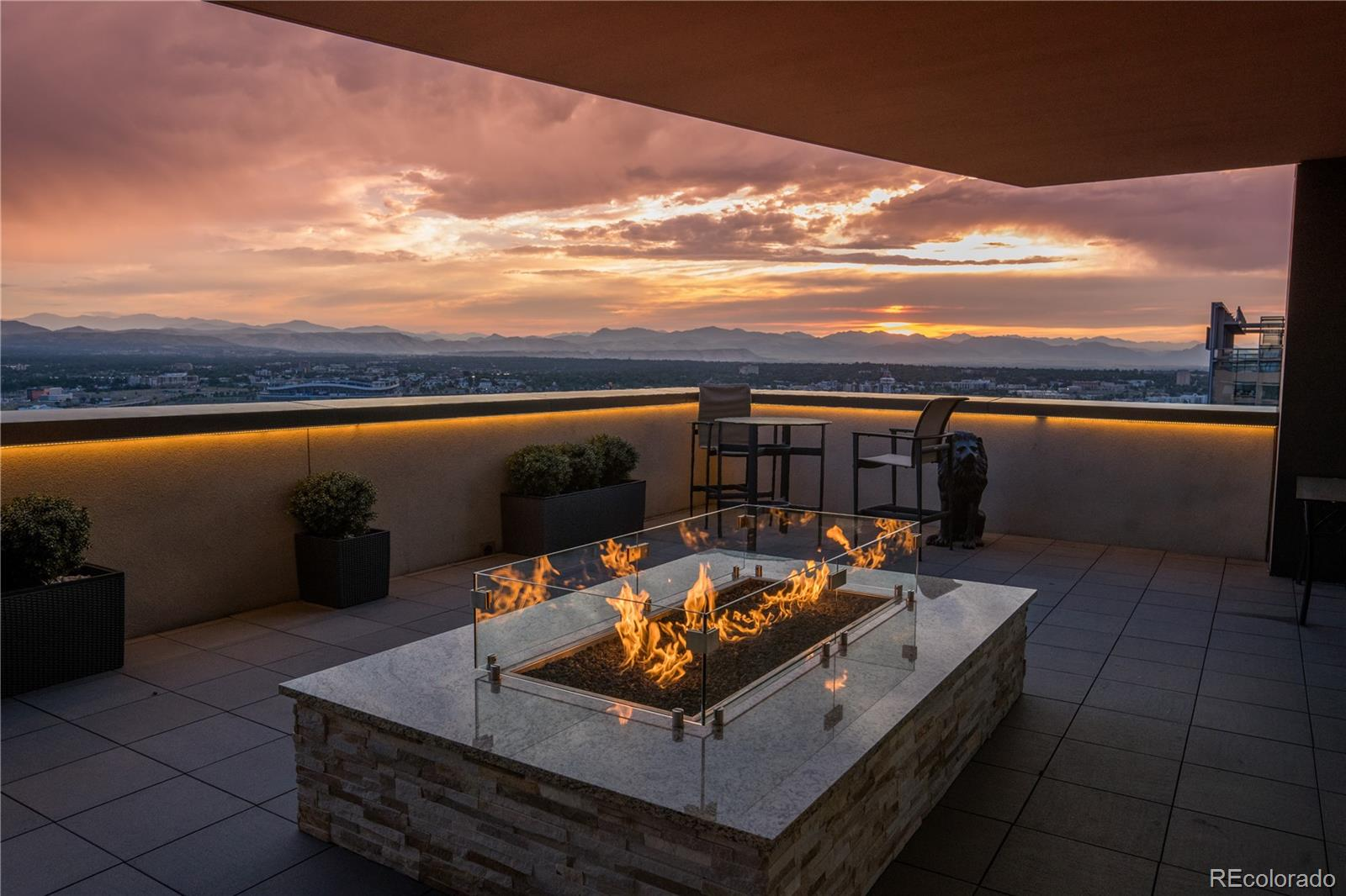 Welcome to Denver Sky Terrace.  It's not hard to imagine where the moniker comes from after seeing some of the images of this incredible home.  Most luxury homes are billed as one of a kind, but this one truly is!  Originally purchased as a single residence, the current owners purchased the adjacent home, and combined the two into something truly special. The list of features is long and precisely what you'd expect it should be - wide plank hardwood floors throughout, granite and stone countertops, custom storage and lighting solutions, Miele and Subzero appliances and home automation throughout.  The design of the home centers on gracious and open living and entertaining spaces, natural light, sun and air,  and of course, unparalleled views of the city and mountains beyond.  However, one of the key elements to what makes this home a one-and-only are the two enormous terraces - 615 square feet each - both with gas lines, speakers, and water hook ups, and one with built-in fire pit and barbecue grill.  It is the only home in the Four Seasons with such spectacular outdoor living and one of the very few that includes 4 reserved parking spaces, and two storage units.  Of course, what truly separates this home from other large residences in the City is that it sits atop the Four Seasons Hotel, which means you'll have access to a set of services and amenities that cannot be found anywhere else in Denver.   This truly is a home that will never be duplicated in Denver again, and now is your chance to own it and make it yours!