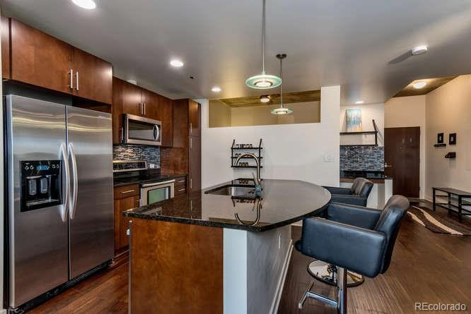 Situated 20 stories above Denver this 2-bed/2-bath SPIRE condo has JAW-DROPPING VIEWS of the Rocky Mountains, Mile High Stadium, Eliches and Downtown Denver! A truly special home. From your balcony, watch the storms roll in from the West and catch the fourth of July fireworks from your front row seat. Upgrades include: Smart lights, nest thermostat, wood floors, new carpet, master bath recessed medicine cabinet, TV mount with hidden wiring, wine rack with custom backsplash, balcony teak tiles. SPIRE is LEED-certified, with many amenities: a heated rooftop pool open year-round, hot-tub, fitness center, multimedia lounge, multimedia theater, garage dog park, grilling area, private event lounge, 24/7 courtesy desk, furnished guest suites, modern security systems, electric auto charging station. Great downtown value! Some of the best views in Denver!THIS WILL NOT LAST LONG HURRY!!!!