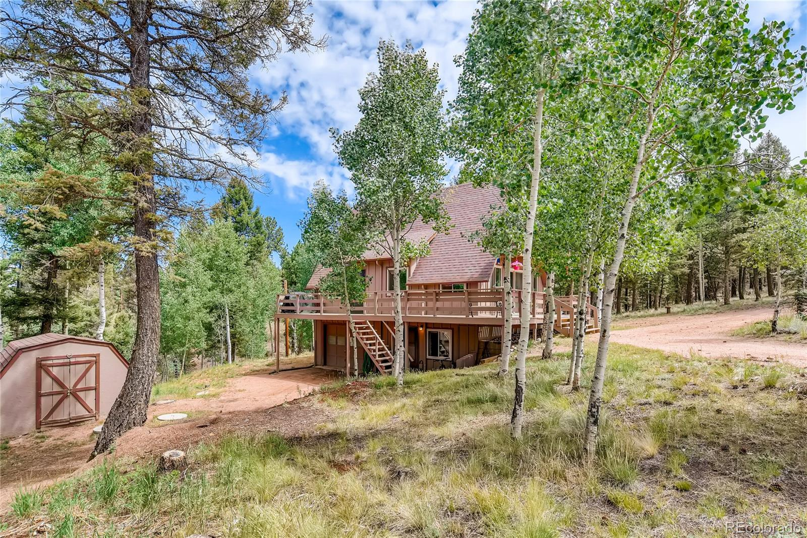 Enjoy this peaceful and private retreat on 1-1/2 treed acres just south of Florissant. This updated country home features a large wrap-around deck, gorgeous aspens and pines, and an easy-access circular driveway (bring the RV and toy trailer). The main level has wood floors, tongue & groove pine ceiling in the living room, a remodeled 1/2 bath, cozy wood stove, large country kitchen and dining area. The upper level has two bedrooms and a full bath. The master bedroom has a private deck for morning coffee or and evening book. Ceiling fans in the living room and upper bedrooms keep temperatures comfortable. The 14x 12 lower level bedroom area has a large closet, 1/2 bath and a private entry door, giving this flexibility for a walk-out family room or guest quarters. The laundry room with has space for a wine cellar, beer brewing or storage. There is an oversized attached one-car garage as well. Three energy efficient Rinnai natural gas heaters and wood stove keep you cozy. Supplemental electric baseboard heat provides total temperature customization. Newer vinyl window throughout. If you are ready for more room to stretch out and enjoy Colorado, this is it! This home is very conveniently located with quick access to Woodland Park and Colorado Springs. Roads are County maintained. Colorado Mt Estates boasts a private entrance to Dome Rock State Wildlife Area, minutes to Florissant Fossil Beds, 20 minutes to 11 Mile Canyon. Work from Home and Play from Home!