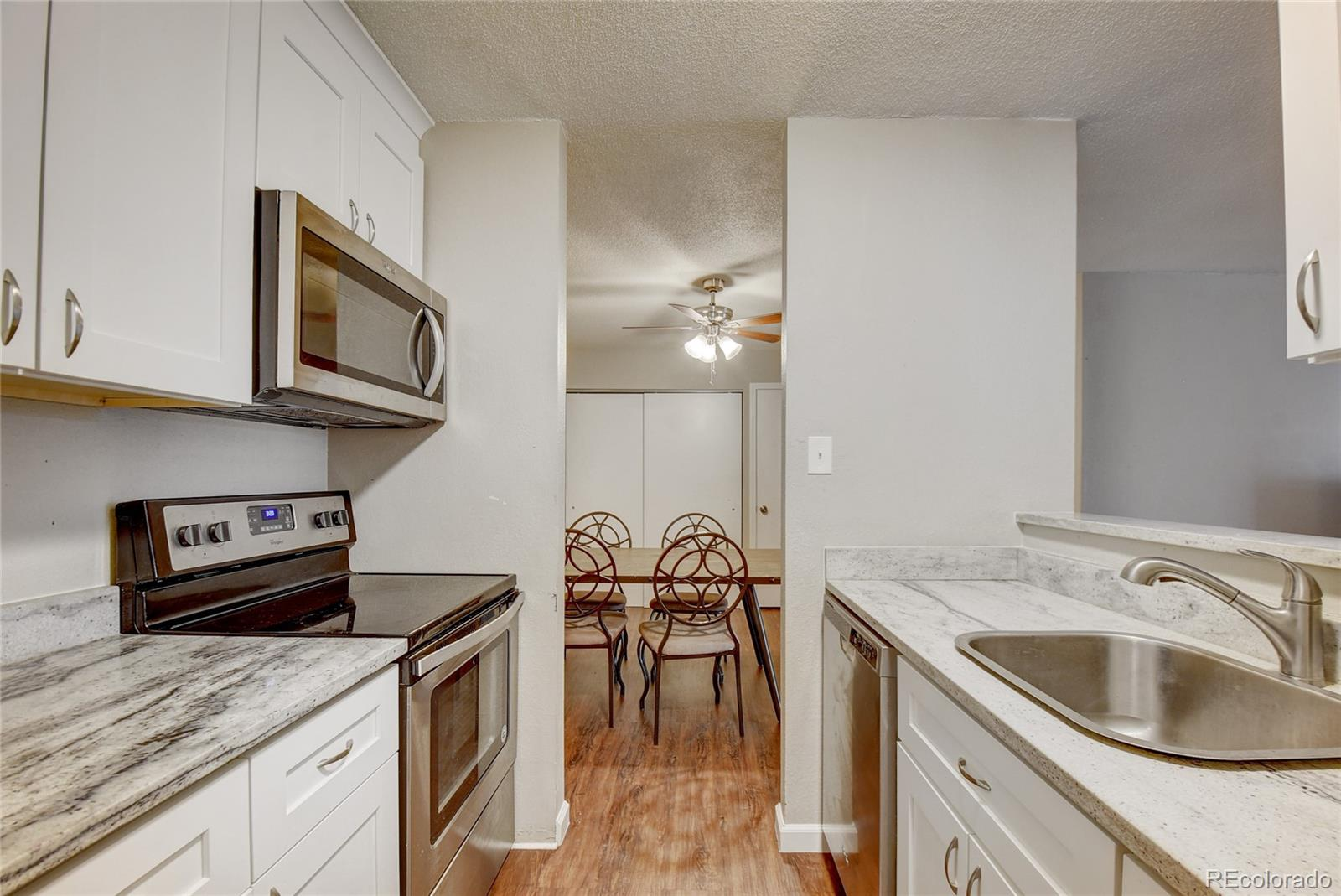 Step inside the best unit under $200,000 in Aurora with this exceptionally renovated 2 bedroom condo. The upgraded kitchen boasts granite countertops, stainless steel appliances, and upgraded solid wood, soft close cabinets. With hardwood floors throughout, upgraded bathrooms, and newer A/C units, this premium unit is truly turn-key. The balcony is closed in with sound proof plexiglass allowing a wonderful view of the grounds without any concerns about noise. The HOA is full service covering heat, sewer, water, and trash. Located near I-225 and Illif in Cherry Creek Schools, this home has easy access to Downtown, DTC, Anschutz, Buckley AFB, and DIA. One reserved spot is located directly across from the stairs up to the unit for easy access. Don't miss out on this beautifully unique opportunity. Ask your agent about the $17,500 grant program.