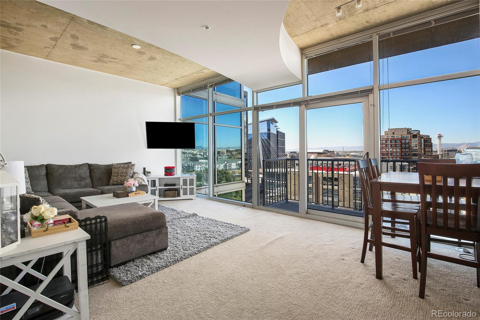 Located on the 10th floor in one of the best buildings in Riverfront Park, this one-bedroom condominium is thoughtfully designed for city living. Inside, floor-to-ceiling windows allow for an abundance of natural light, with an open floor plan and modern concrete ceilings. Relax on the spacious balcony and enjoy views of Commons Park, the Rocky Mountains, and Downtown Denver, or step right outside the front door to experience Denver's finest restaurants, shopping, museums, and entertainment. The Glass House features a wide range of amenities, including an outdoor pool, theater room, health club, business center, community room, and concierge desk, with easy access to Union Station, LoDo, and LoHi. Residence includes new carpet, washer and dryer, walk-in closet, and a parking space.