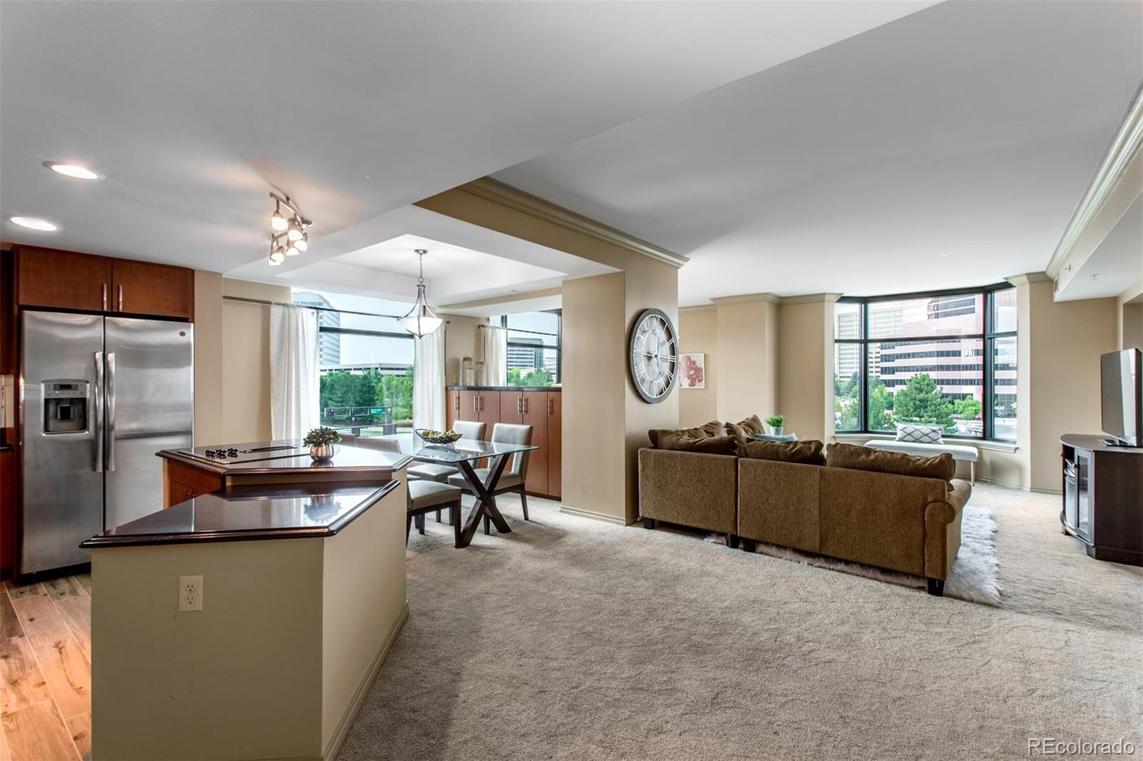 Spacious 1,100 square foot 1 bedroom condo in the impeccable Penterra Plaza! Located in the heart of the Denver Tech Center (DTC), this well maintained home is recently remodeled and features private balcony with mountain views. Upon entering this home, you are welcomed by a bright entryway flowing into the open concept floorplan. The kitchen features stainless steel appliances, an oversized island and granite countertops. The kitchen seamlessly connects to the dining room with large windows allowing an abundance of a natural light. The living room and den combine to create a spacious living space, that feels cozy with a comfortable nook to read a book, or with plenty of room for a home office. The recently remodeled bathroom has plenty of cabinet space and a large granite vanity with dual sinks. The master bedroom has a large walk-in closet, and access to the West facing balcony! Other highlights of home include in unit stackable laundry, reserved garage parking, and reserved storage space. Penterra Plaza is a renowned building including luxurious amenities like an onsite concierge, impressive fitness facility, business lounge, community room and 2 rentable guest suites available for just $80/night. Truly move-in ready this low maintenance condo is perfect for a luxurious, worry-free 2nd home, long term rental or full time residence for the busy professional.