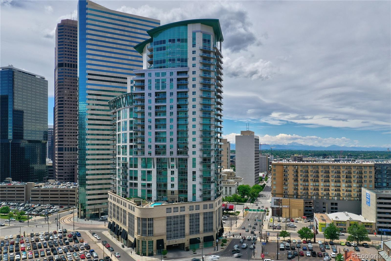 20K Price Drop Seller's Loss Your Gain!  Ready To Experience Denver's Amazing Skyline & Feel A Part Of The Energy Our Great City Offers All While Living In One Of Denver's Safest & Most Secure Building's?  Then This Immaculate 1 Bed 812 SF Condo Located In One Lincoln Park Might Be For You*Lowest Priced Unit In Building!  Downtown will be fully open in the near future & this is your opportunity to get a deal while the opportunity exists*Perfect for 2nd home or lock and leave living also*Enjoy Breathtaking Views Of Denver's Cityscape & Full Front Range Mountain Views From Every Window In This 21st Floor Unit That Features A Large Gourmet Kitchen w/ Slab Granite Counters, Stainless Appliances, Gas Stove & Enormous Walkin Pantry & Laundry Space*The Open Light Filled Design Is Perfect For Entertaining*Watch Sunsets Or The Sun Rising As It Hits The Mountains While Sipping On A Glass of Wine or Morning Jo From Your Spacious Balcony*Wake Up Every Morning To Spectacular Views From The Master Suite & Get Ready In Your Luxurious 5 Piece Bath w/ Dual Sinks, Granite Counters & HUGE Walkin Closet With An Included Elfa Custom Organization System*One Lincoln Park Has So Many Amenities You May Never Leave Like A Full Time Concierge To Receive Guests & Packages, State Of The Art Fitness & Weight Room, Clubhouse That Can Be Rented For Special Events & A Fabulous 7th Floor Pool Area*Available Guest Suites Can Be Rented For Just $80/night*This Unit Includes A Covered Parking Garage Space PLUS 2 Storage Units To Keep Your Bikes, Xmas Decor & More*Denver's Best Location To Get Anywhere Downtown Like Light Rail Just Across The Street, Bars & Restaurants Minutes Away & Coors Field a Short Walk*You'll Also Enjoy Quick Commutes To DIA or the Mountains*One Lincoln Park Has It All For The Person Who Wants It All