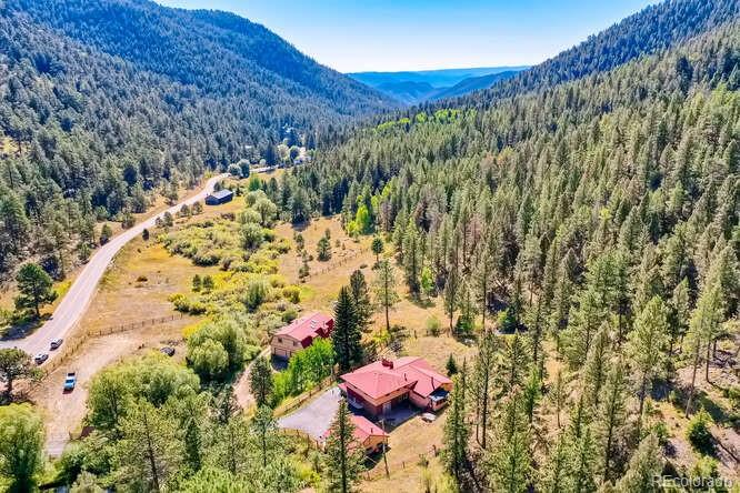 Rarely does a property like this come on the market, within 45min of Downtown Denver!! Build your custom home on one of a few great building sites, or enjoy the existing Mountain Contemporary home that currently exists. An Incredible 200+ acres of forested land in Conifer with classic mountain beauty, lovely meadows and vistas, and carefully maintained by the owners for healthy forestation. Private and serene with easy access to town and high mountain recreation. Solid contemporary-style home with attached garage and a separate detached garage. There is also a separate barn with more than 4 garage spots and guest/living quarters/art studio/office above. Property includes a nicely built and maintained storage shed/tack room and 2 outdoor stalls. Total building areas of 7039 sq. ft. 5 bedrooms, 4 baths, and 10 parking spaces. Your options are endless, from equestrian operations, many agricultural opportunities or hike from you front door, southwest almost 1,500' up to Riley Peak, one of Jefferson Counties best Rocky Summits!