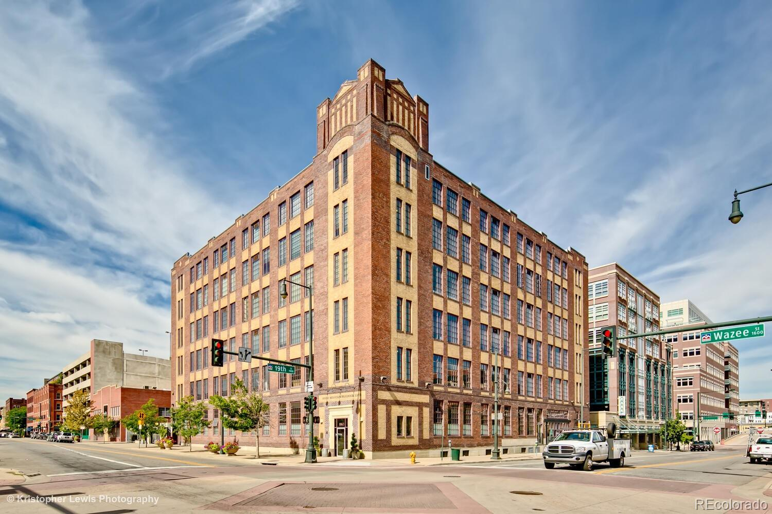 A charming industrial-style penthouse in the historic Rocky Mountain Warehouse Lofts building & LoDo neighborhood. This home features many architectural details – polychromatic brick walls along the dining & living room, exposed concrete pillars and ductwork throughout, an open and bright floor plan with many windows, tall ceilings, & views of the city, custom kitchen cabinets & floating bathroom cabinets, & intricate tile patterns. The open floor plan has hardwood floors throughout and allows for many different layout options - with enough space for an office, home gym, etc. A spacious kitchen with induction cooktop, quartz counters & island seating, soft-close cabinets, stainless steel appliances, & built-in coffee machine. A large master bedroom with a spa-like bathroom with a spacious shower that has multiple shower heads including a rain-style & handheld wand, and a jet bath tub. In unit washer and dryer. Enjoy entertaining on the large covered balcony with outdoor grill and plant herbs or flowers in the raised garden beds. Tandem parking spots in the secure underground parking garage that also has a storage unit. In the heart of downtown - live steps away from Coors Field, Dairy Block, McGregor Square, Union Station, and all of the LoDo shops and restaurants. Live a part of Denver's history – the building was built in 1930 by influential architect Montana Fallis and was originally used as one of Denver's first merchandise marts. To view a virtual 3D Tour Click Here: https://my.matterport.com/show/?m=uzWdHCyb7fU