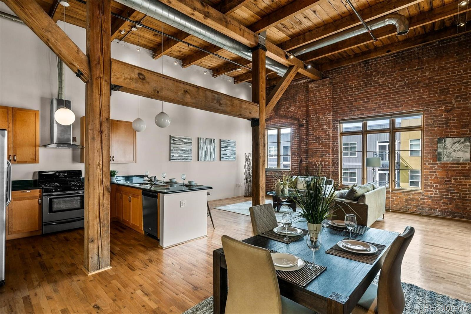 Own a piece of architectural history with this show-stopping, brick and timber residence, in the Watertower Lofts. This end unit's design features include 16' ceilings, exposed brick, oversized windows which provides a dramatic bank of natural light, timber beams, hardwood floors, and a spacious balcony with city views! The well-equipped kitchen boasts granite countertops, a peninsula with bar seating, abundant cabinets, stainless steel appliances, and pantry. Built in 1896, the building was converted to lofts in 2002 and provides locked entry door to a welcoming lobby. Gym facility, and extra storage space are in the lower level. As an added bonus, one deeded parking space in the covered and secure community garage. Located in the heart of the Ball Park Neighborhood, this loft is just three blocks to Union Station and only a casual stroll to Coors Field, LoDo, RiNo and more. Experience the coolest loft building in town!