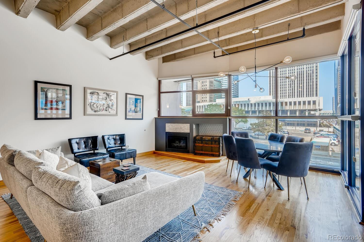 Looking to make a move to Downtown Denver? This is a great opportunity to get into a wonderful loft condo in the heart of Downtown. Steps from the preforming arts complex and all the wonderful shows there. Why rent when you can own this wonderful piece of property that is turnkey. This unit can be sold furnished so, if you are looking for a corporate rental this unit is ready to go. Complex allows semi short term rentals (30 days minimum) and this unit would rent fast. New office building being built next door. Livewire broadband to unit, which allows for extreme fast internet and wifi. This complex also has a 24 hour front desk concierge. . Enjoy the vaulted loft ceilings and open floor plan with walls of windows letting in natural light and views of the bustling city. You are able to look out and see the city, but stay private in your own enclave as the outside can't see in. A gourmet kitchen with custom cabinets, granite counters, stainless appliances and a gas range to cook up your own masterpieces when you don't feel like walking to the many wonderful restaurants Downtown. Designer updated bathrooms with custom vanities.  Cozy up to the gas fireplace, enjoy a good book or Netflix show in the winter while watching the snowflakes cover the city. Take some time for yourself on the roof top pool/sundeck or the complexes gym. Complex also has a conference room available to rent. This unit comes with a deeded oversized wide parking spot steps from the elevator, so if you want to escape to the mountains for skiing or hiking, grab you gear from the storage locker, and head to your car. If you enjoy theatre, sports, or events, this is the place for you! This place is minutes to the preforming arts center, Pepsi Center, Coors Field, ect. Come home to the city!   HOA includes heating, air conditioning, water, trash, recycling, heated garage, window washing 2x per year, security, consierge, in addition to all the amenities and building maintenance.