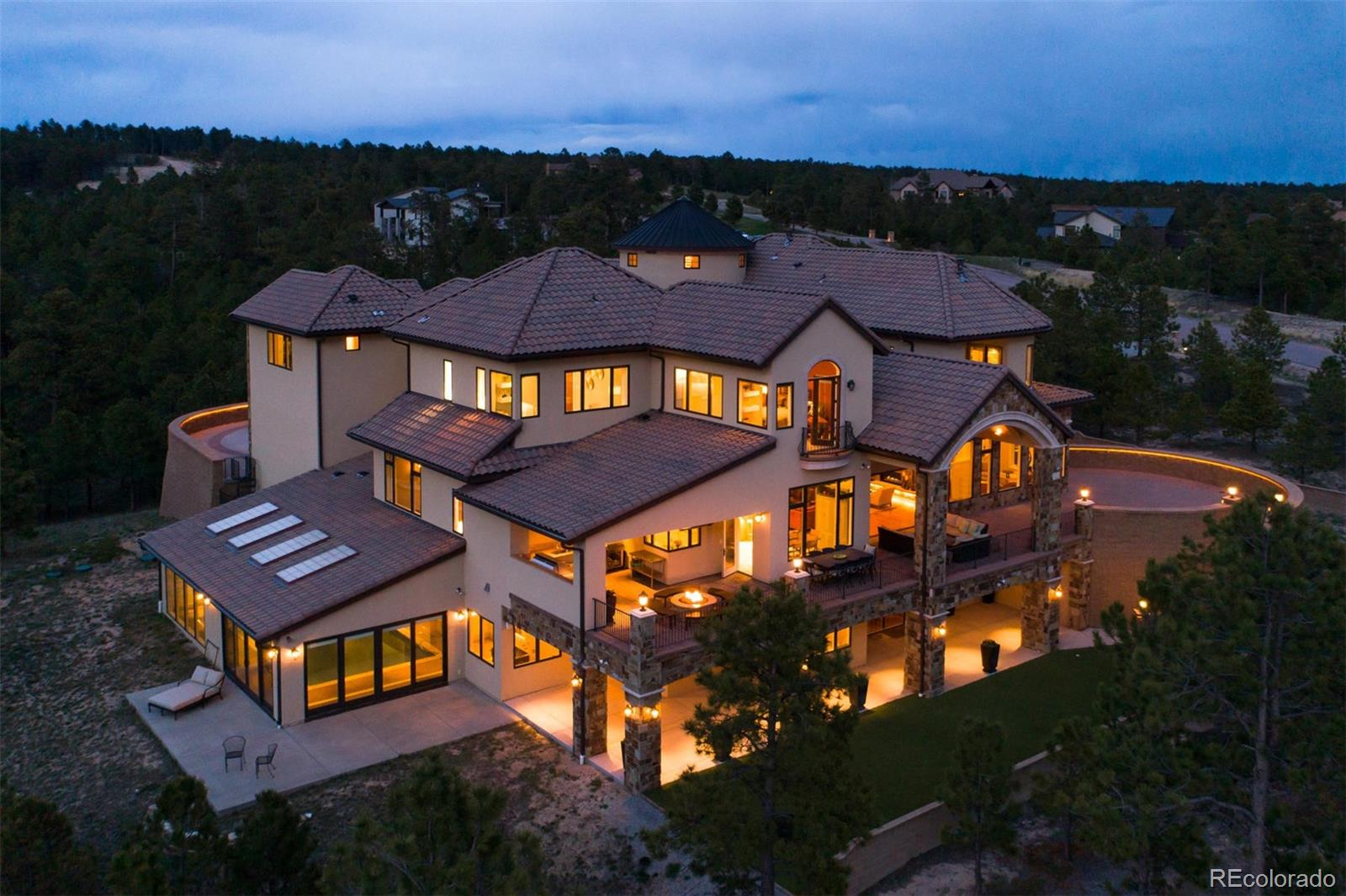From the moment you enter this grand home, you will experience a feeling of calm.  A safe haven nestled in the Ponderosa Pines of the Black Forest. One of Cathedral Pines most unique homes, blending grand living with warmth and privacy. Stunning two story foyer showcases a floor to ceiling waterfall. Open Floor plan flows effortlessly with amazing light filled interior courtyard at the center of it all with snow melt and lighted stone tiles in the floor. Perfect home for entertaining both inside and out. Accordian doors from great room open to a beautiful covered deck.  Enjoy amazing views of the southern mountain range including Pikes Peak. Two outdoor kitchens, full butlers pantry with easy access to kitchen & dining room. Amazing chef's kitchen with two large entertaining islands and high end appliances.  Two master suites one on the main floor and one upstairs  with views, walk-in closet and jetted tub. Large lower level entertainment area with theater room and separate arcade room. Custom wet bar and wine room with seating. Salt water pool and sauna  located with easy access to workout room. Two ensuite bedrooms complete the lower level.  A perfect combination of spaciousness and privacy.