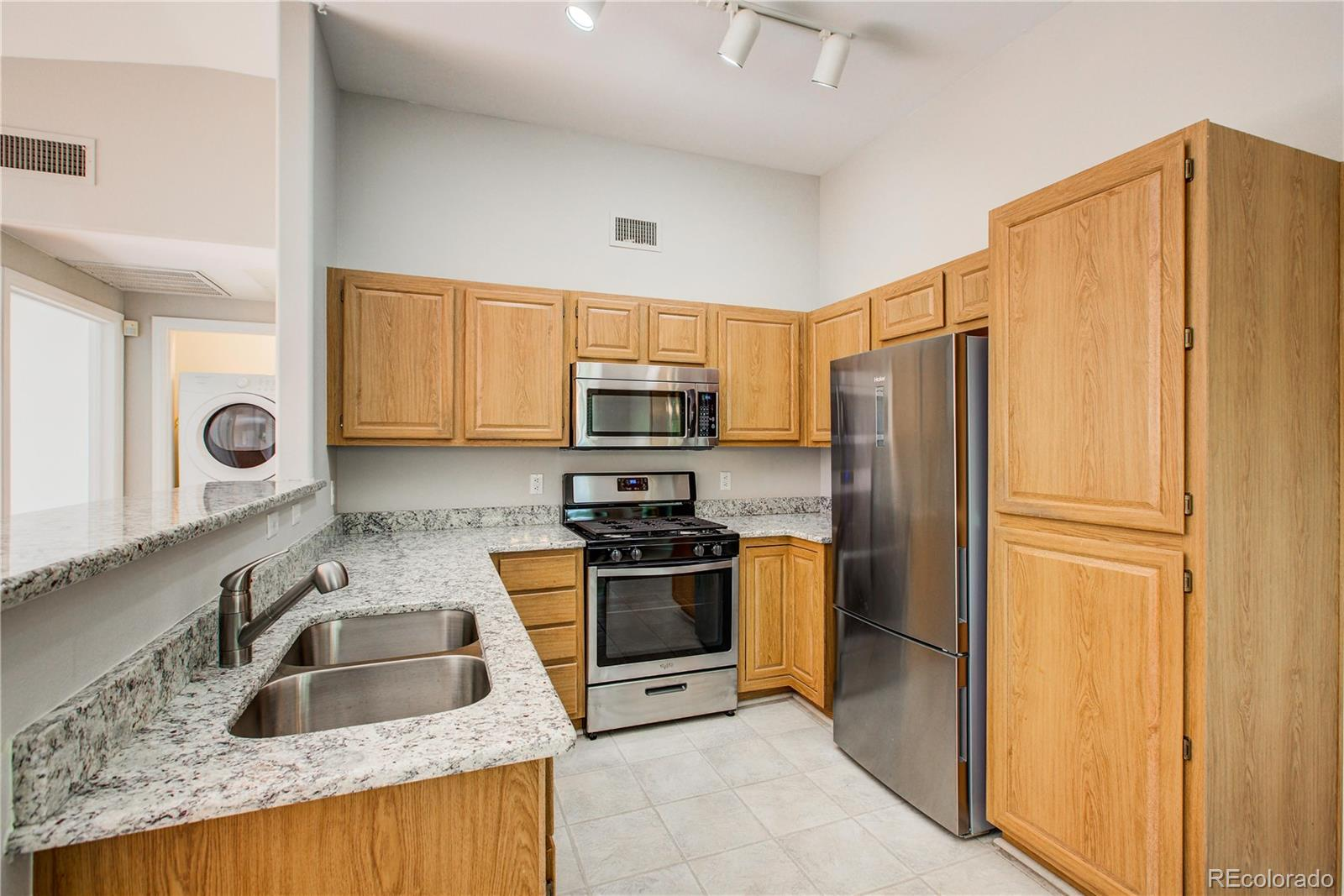 Don't miss this large updated 1 bedroom, 1 bathroom condominium in Highlands Ranch within walking distance to shopping and easy access to C-470. Mountain Views! The kitchen has granite counter tops, stainless steel appliances including microwave and new dishwasher. New stove and refrigerator!! Beautiful Southeast light floods the entire property and  you will love relaxing on the deck off the living room!  The master bedroom has a walk-in closet and bathroom just outside the hall with double sinks.  No need for a gym membership, this amazing community includes a fitness center and pool within walk distance of your new home. Quick closing available.