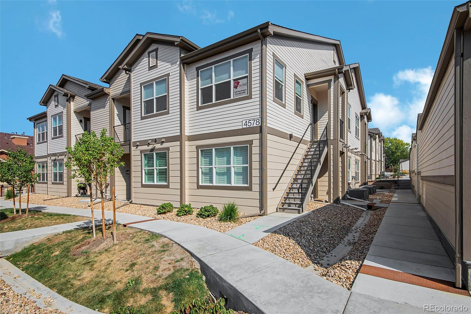 Stunning, Move-in ready, Copeland Canyon Condo. Only 1 year old! This property features a great open floor plan with 2 bedrooms and 2 bathrooms. Beautiful flooring throughout, high ceilings, and a private balcony with storage! Fantastic open kitchen with granite countertops, stainless steel appliances, and kitchen sink with a single pull faucet. Matching bronze features throughout. Large island with seating overlooking the dining area and family room.  Master Suite with private bath and large walk-in closet, plus a second bedroom and full bathroom. Detached garage and one dedicated parking space. Close to C-470, dog park, miles of biking trails, Park Meadows Mall, and tons of dining!