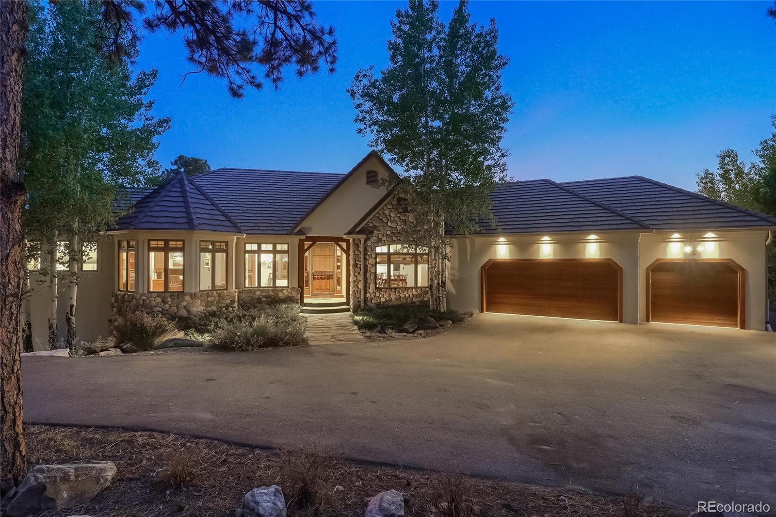 Unbelievable Custom Ranch Home Backs up to over 30 Acres of Open Space w Fantastic Mountain Views. Tradition & Style Exudes from this Beautifully Appointed Estate Nestled amongst Mature Pines & Aspens offering 4 Beds, 6 Baths, Finished Walk-out Basement, 1,400 Bottle Wine Cellar, Abundant Living Space & an Attached Over-sized 844 SqFt 3 Car Garage. Elegant Features of this Remodeled Upgraded Home begin w a Bright Vaulted Living Room enhanced w Wood Beams, Wall of Windows framing Amazing Mountain Views, Gorgeous Hardwood Floors on Main Level, Wet Bar, 2 Fireplaces & Multiple Deck Access; Points for Fabulous indoor/outdoor Entertainment. Walk-out Basement has Expansive Sunlit Family Room w Great Vistas, Gas Fireplace, Wet Bar & an Exquisite Custom Mahogany Wine Room. Step outside onto a Spacious Lower level, no drip Covered Deck; Perfect for Relaxing & Entertaining. Main Level Great Room has Fireplace & Upper Deck access. Gourmet Kitchen has Slab Granite Counters, Huge Quartz Island w Breakfast Bar, SS Appliances includes New Double Ovens, Gas Cooktop, Beautiful Cabinetry, Pantry, Sun filled Breakfast Nook w Access to Deck w gated access to Spiral Staircase connecting Upper & Lower Maintenance Free Decks. Spacious Main Level Office has Built-ins & Desk. Master Retreat w Sitting Area & Walk-in Closets. Luxurious 5-Piece Master Bath has Freestanding Air Jet Soaking Tub, Large Steam Shower, Water Closet, Tile Floor. 3 more Sun Lit Beds in Lower Level all w Beautiful en Suite Baths & Bonus Room, Ideal as a Workout Room. Main Level has Large Laundry w Cabinets, Counter Space & Utility Sink, Powder Room & Mud Room. New Stucco Exterior. Xeriscape Landscaping & Hardwired Landscape Lighting. 3 Flagstone Patios in Back, 1 w Gas Firepit, lower has Pergola, & 3rd near deck has 50 Amp Electrical Panel (supports future hot tub). Only a Few Minutes to Shopping, Dining & Trails. Close to Golf & Evergreen Lake. Just 30 minutes to Denver. See Virtual 3-D & Aerial Tours.
