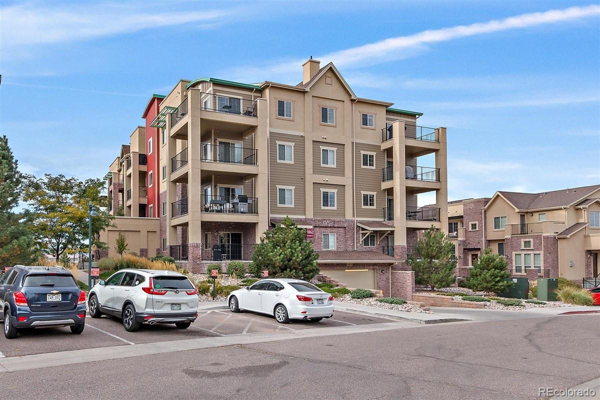 Like New! Stunning Clocktower Condo.  Largest square footage.  You must see the views of the mountains and the Denver skyline!! **Beautiful condo unit with 2 bedroom and 2 baths, and a den or playroom **Open, sunlit and spacious! Secure building with elevator*One car parking space (S8) in heated garage along with secured storage. Access to the Highlands Ranch rec centers is available with this condo. **Clocktower condominiums is a short walk to the Town Center, there you will find boutique shopping, fabulous restaurants, Irish Pub, and Sunday's farmers market.  This HOA includes gas, water, trash, recycling, and you can enjoy all the benefits of living in Highlands Ranch including the 5 different community rec centers, pools, and walking trails.  It's the best of both worlds close to Town Center and still quiet and peaceful.  Must see today!