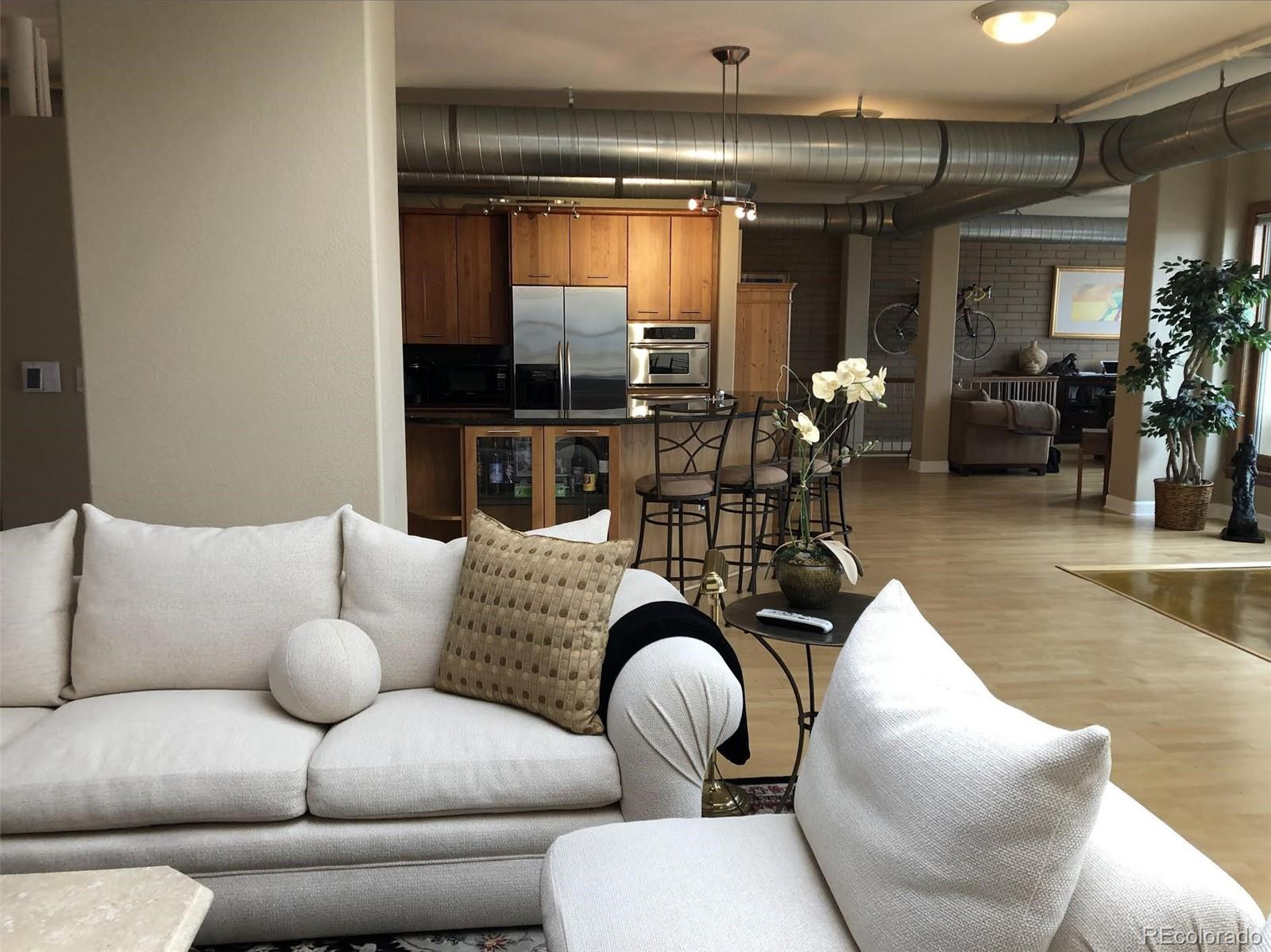 """This exclusive residential loft is unlike anything else that currently exists in Downtown Denver. The owners  spent years renovating both Penthouse units and a 3rd adjacent unit to individually occupy the top two floors of the building which is located next to Coors Field. If you desire a lot of open space, this is one of the largest residential lofts in Downtown Denver at nearly 7000 square feet. The loft has multiple entrances on multiple levels. There are 3 outdoor decks - 2 of which are west facing with unobstructed views of the mountains and Coors Field and the 3rd deck runs the entire length of the building with facing the downtown area. The open floor plan with two full master suites is flexible and enough to configure into as many bedrooms as desired. The loft boasts 7 bathrooms - 6 full baths and one half bath, 3 steam showers and 3 Jacuzzi tubs. There are 2 full gourmet kitchens, multiple entertaining bars, and 2 fireplaces. You will enjoy complete privacy with no upstairs or adjacent neighbors. The unique architectural design allows for the ability to close off areas allowing them to be completely self-sustaining and soundproof to function as a guest house or """"mother-in-law"""" residence with separate entrances, bathrooms, kitchen, and other wireless systems. The loft has a full security system with multiple interior and exterior cameras, off-site camera footage storage and a fully concealed safe room integrated into the system. 4 parking spots are yours and also an option for high-demand hangar space at Centennial Airport for personal aircrafts. The loft will be sold fully furnished including baby grand Disklavier piano. In order to protect the privacy of the current owners, as well as the privacy of the exclusive buyer, limited photos will be publicly posted, but additional photos and videos, and in-person or virtual showings may be arranged after receipt of a Proof of Funds (POF) Letter and/or a Prequalification Letter to the current owners."""