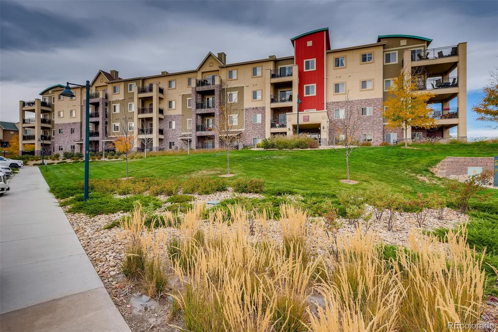 Spacious low maintenance two bedroom condo in the heart of Highlands Ranch at Town Center offers walkability to beautiful Civic Green Park, retail shops, restaurants and the local library. This bright and open floor plan features a gas fireplace to keep you warm during those cold winter evenings, abundant seating at the kitchen island, additional space for a dining table, in unit washer and dryer and two large bedrooms. The main bedroom has its own ensuite bathroom and large closet. Entertaining is easy with the double slider doors providing access to the outdoor patio with ample room for a grill and patio furniture. The back patio overlooks a nice little green space, and even has peek a boo mountain views! This well maintained main floor unit offers the convenience of no stairs to access your home. Enjoy all that the four Highlands Ranch Recreation Centers have to offer with your monthly HOA dues!