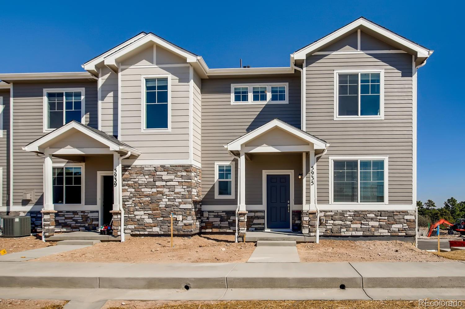 """Luxury Townhome in the heart of Castlerock with an April/May 2021 completion! The beautiful Adderbrooke is a 2 bed, 2.5 bath, with oversized attached 2 car garage. Kitchen includes stainless steel appliances, granite countertops, gas range, dishwasher, and built-in microwave.  Open floorplan with spacious living area and fireplace, upgraded chef's style kitchen with upgraded cabinets, dining space, and is perfect for entertaining.  Both bedrooms have en-suite bathrooms providing privacy and making it a great roommate layout.  Upstairs laundry conveniently located near both bedrooms, and loft area makes for a cozy office space.  Includes energy-efficient furnace, A/C, tankless water heater, and 2"""" white blinds. Right outside your back door, you can enjoy miles of walking trails through the beautiful scenery of the nature filled canyons. Don't miss out on living at The Enclave, just moments away from major highways, shopping, dining, award winning Douglas County Schools, and multiple outdoor activities!"""