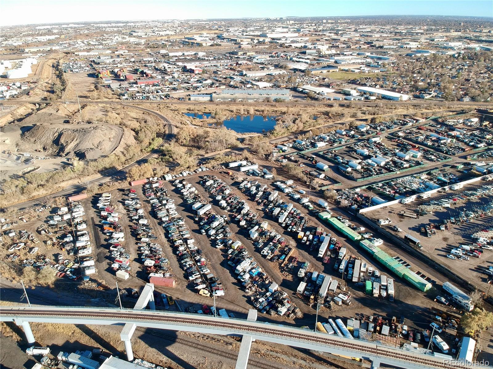 Great location .8 mile from National Western Center, 8 minutes from downtown Denver. Near I-70, I-76, I-25 and Hwy 36. Abuts light rail. Very secluded with BNSF Railway on one side and D&RCW Railway in back. Currently used for open storage. There is a 10' x 15' office & 15' x 20' additional building. Water & sewer on property (no natural gas). Price includes license for Salvage Yard (which is almost impossible to obtain in Denver. ZONING:  I-B OU-2, Commerce City I-3. Lots of possibilities for your business!