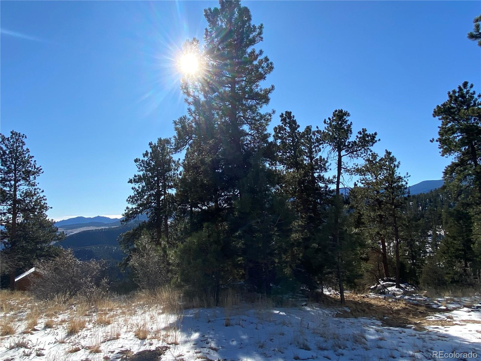 Big Beautiful Unobstructed VIEWS to mountains, Trees and Sunshine.  Quiet  near the end of the road peaceful valley ambience.  Ready to develop and  Build a new mountain  dream home in Bailey.  Borders large 200 acre parcel