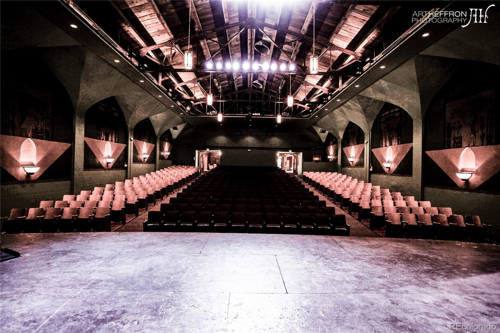 Have you ever thought about living in an Historic Theater?  If so, this is the one!  Nestled in the heart of Highland, on one of the most prominent corners in the neighborhood is this historic gem.  The Holiday Theater!  The theater has a footprint of over 6,300sf with up to 30' ceilings. The potential is endless!  This mixed-use building with both retail and residential units currently generates $280,000 in gross revenue per year.  Built in 1914 as a mixed-use building, this iconic gathering place includes 15 residential units, 1 retail unit, 2 office units and the beautifully appointed classic theater. It was originally called the Egyptian theater then later renamed the Holiday, it exemplifies all of the drama of the theaters of that era with a tasteful facelift 8 years ago. The property has been meticulously maintained over the years and has several original appointments. The 5,000+sf theater and two retail units are the perfect adaptive re-use opportunity for your creativity to run wild.  The building is currently fully leased (except for the theater) and has had several upgrades throughout the years.  The property is not a contributing structure in the Potter Highland Historic District and has no historic status at this point.
