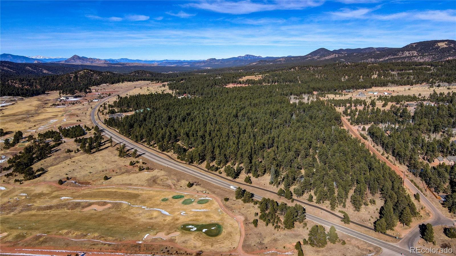 Prime land ready to be developed! One of a kind 20.61 acre zoned PUD inside the city limits of Woodland Park. Amazing views of Pikes Peak and the golf course make this property ideal.  This turn key project is ready to run with and the City of Woodland Park has already approved the preliminary plat for a 26 unit residential subdivision.  Initial engineering phase is complete, survey is included, CDOT approval has been granted.  Located on city utilities this is a developers dream.  With housing inventory at an all time low there is no greater time to develop this parcel.