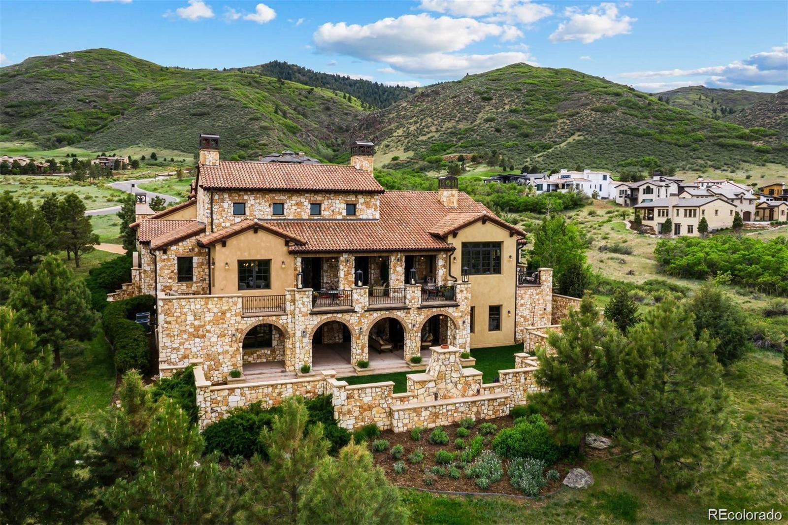 Spectacular CUSTOM ESTATE resting on RAVENNA GOLF Community's most impressive 18th TEE BOX HOME SITE! METICULOUSLY appointed to accommodate daily living in uncompromising Style & Luxury. Providing BREATHTAKING views of the mtn's, GOLF COURSE & clear to the DENVER SKYLINE!  It's an oasis for sophisticated entertaining; inviting PARADISE inside thru its landscape & numerous outdoor Stone Retreats. The interior echo's this ambiance through the architect's eye for QUALITY & DETAIL as seen in imprinted stonework & rare marble slabs. Only the FINEST MATERIALS have been incorporated as demonstrated in its EUROPEAN KITCHEN, old-world GUEST HOUSE & Venetian inspired WINE CELLAR & TASTING ROOM. Just a short drive to DTC and Downtown, yet seemingly worlds away. For those who prefer a unique escape to a SERENE, luxurious ESTATE AMONGST NATURE. This is the ultimate statement of Privacy & Prestige!