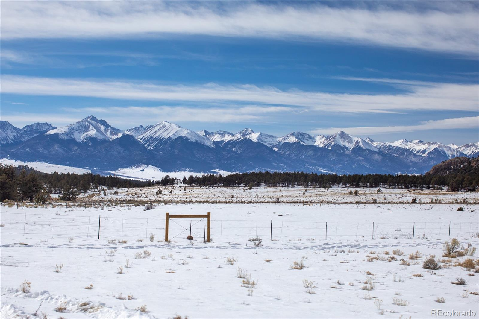Your opportunity to acquire a premium property in Westcliffe, Colorado that has it ALL and NO HOA! COMMANDING MOUNTAIN VIEWS of the SANGRE DE CRISTO MOUNTAIN RANGE throughout the property. Wet Mountain Views. LIVE WATER from a Spring Fed Rocky Mountain Stream, High producing well, Forest, Meadow Lands and grassy pasture.  Fencing is ready for your animals! Driveway is in, buried power, septic, NEW 2400'+/- Fully heated HORSE BARN, with plumbed wash area for bathing horses, Dutch stall doors with direct convenient access to large paddock. Hay loft. Automatic heated waterers. Full bathroom and kitchen. Aspen and pine tung and groove. Multiple power garage doors with pull through RV parking area (could be converted to more stalls). Two RV hookup areas, both inside and outside barn! The well has added hand pump to keep water available during a power outage. Grow year round in your NEW 18'x36' GREEN HOUSE, fully secured to concrete foundation with heavy wind and snow load ratings. 8mm panels hold heat in for year round gardening. Automatic vents and fans for cooling and thermostat controlled propane heater. Outlets and lights. Two additional fans for air circulation make for a healthy growing environment. Complete with recently purchased  Sun Shade for staying cool in summer months. Ten waist high planter beds for easy access. Plenty of room for trees. LED lighting for night gardening and water connection inside for easy irrigating. Don't miss out on this chance to build on some of the very best Westcliffe, Colorado has to offer right in the incredible WET MOUNTAIN VALLEY area. Pristine and scenic location is also convenient to miles of national forest. (This property is currently being offered BOTH as 100 +/-  acre track OR SPLIT 65 +/-  acre plus barn, green house, roads, septic, well and power.) 3D VIRTUAL TOUR is attached to this property! Also see property website for more photos and drone video footage. Appointment required. Information must be verified by buyer.