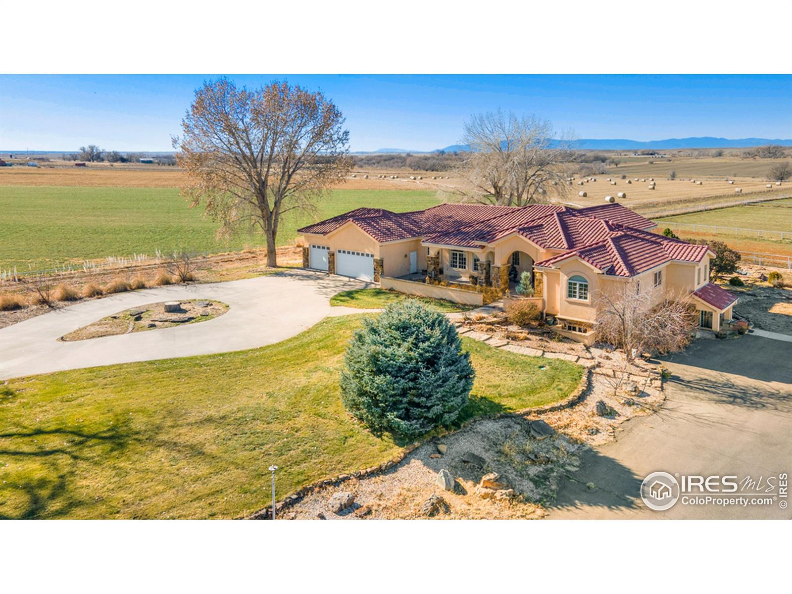 Over 131 acres of farm land, outstanding equestrian facilities, irrigated hay fields & a beautiful showpiece stucco home w/ stone accents & Spanish tile roofing. Climate controlled 12 stall barn, indoor & outdoor arenas, hay storage, breeding shed, loafing sheds, workshop, 2 barn apartments w/ arena viewing. Great room w/ cypress ceiling & arched windows. Cherry wood built-in entertainment center & a copper and granite fireplace. Gourmet kitchen w/ granite & large island. Stainless appliances, copper backsplash, Thermador gas range & double oven, & built-in refrigerator. Formal dining with tray ceilings & built in china cabinet. The master wing has a large bedroom, luxury bath, a large custom closet, & study w/ granite desk, fireplace & bookcases. The guest has 3 bedrooms, w/ en suite baths. Finished walkout basement complete with wet bar/ bar seating, a rec room, theater room, dog wash station, & bedroom. 40 shares of Bessemer ditch water. Multiple virtual tours & more info available!