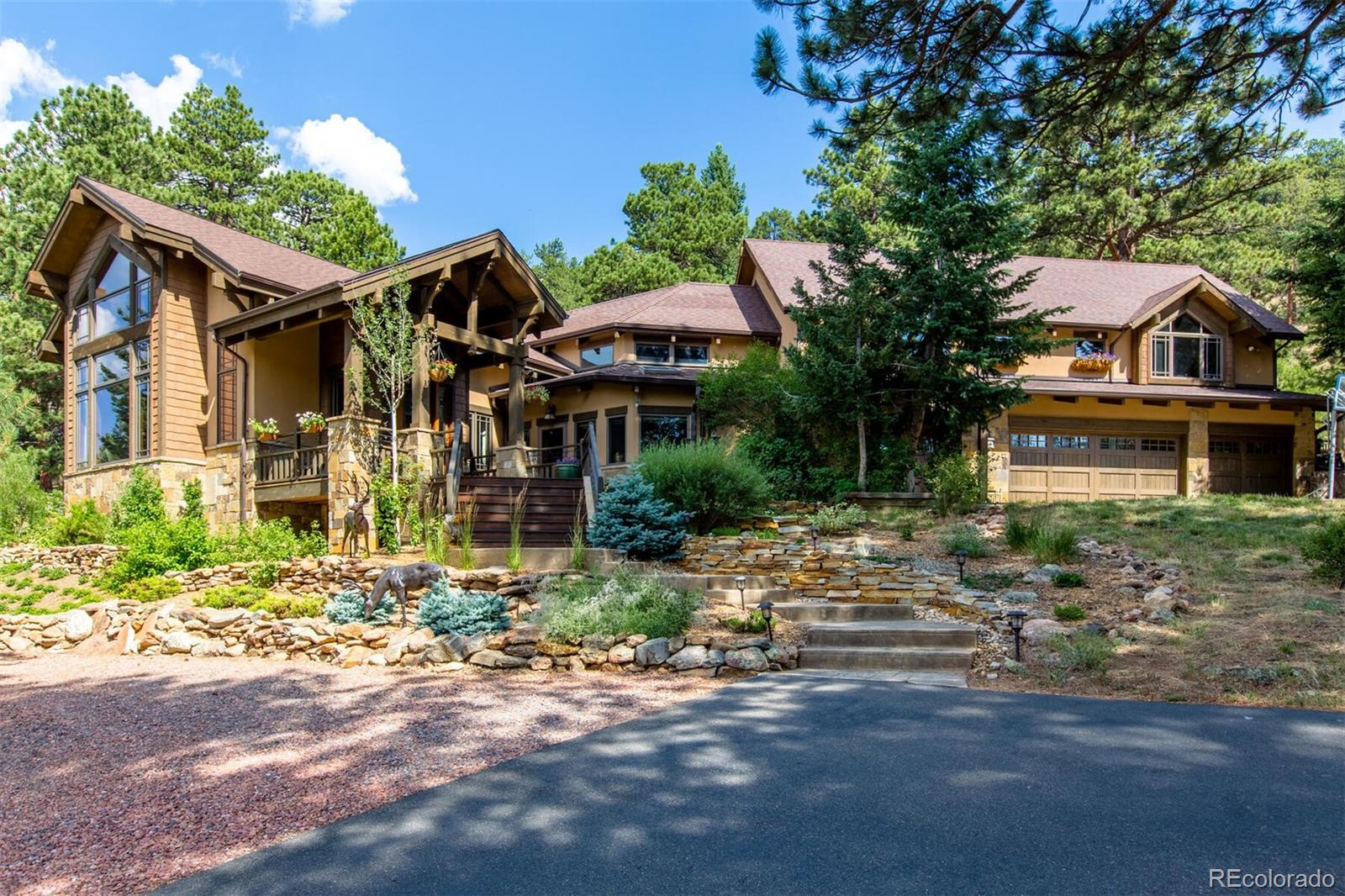 Renovated arts & Crafts style home within Evergreen's most picturesque valley makes you feel so far away, but is  just 7 minutes to Bergen Park or I-70.  Supremely private south-facing 12.4 acre setting is home to massive ponderosas, stands of aspen, bobcats & bugling elk. Mtn, views are framed by 2-story great room windows, so.-facing naturally lit bedrooms & beveled glass doors. Gentle sunny circular driveway leads to stucco/stone exterior enhanced by architectural elements designed by TKP Architects & created as part of a 2012 great room addition with exterior updating. Fabulous great room features a soaring tongue-n-groove ceiling, exposed beams, hickory floors, Hubbardton Forge chandeliers, custom stone wood-burning fireplace & built-ins with hidden TV.  Formal dining has lit cabinetry & slate flooring that extends into the remodeled Chef's kitchen with patio, cherry cabinets, hammered copper sink, butcher block center island, slab granite tops with built-in breakfast table, glass backsplash & top-of-the-line appliances: Viking 6-burner gas cooktop with copper hood & pot filler, full size GE Monogram refrigerator, convection oven & GE Profile speed cook microwave+warming drawer. Sky-lit sitting area has arts & crafts chandelier & built-in desk. Family room & sky-lit exercise area offer a wet bar, patio access & full bath to provide flexibility for conversion to a future main floor master. Mud room with cubbies is off the updated laundry. Double stairways to upper level. Custom wrought-iron balusters with leaf motif. Big master is finished with a beautiful stone & iron gas fireplace+ view deck, 5-piece bath with heated tumbled marble floor, multiple shower heads in walk-in shower, soak tub, slab granite vanities, big over mount sinks, glass block accents & large walk-in closet with professional organizers. Upstairs office/play room provides privacy for 3 ensuite bedrooms. Kids' den has counter study space.  Wonderful view patios include gas fireplace & firepit.