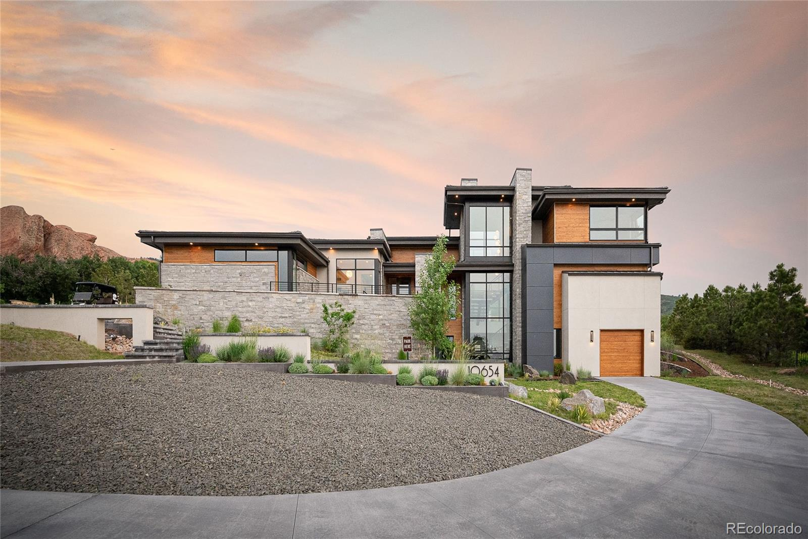 Stunning Modern Estate now available at Ravenna on nearly an acre. Rare, once-in-a-lifetime opportunity to own this super custom home on one of Ravenna's best homesites. Not a detail is missed as this home has been carefully designed to take advantage of the red rock outcroppings, city and 180 degree mountain views. Upon entry from a suspended walkway, an entry foyer invites you into a great room with floor to ceiling glass and plenty of natural light. The main level is highlighted by a custom kitchen and pantry by award-winning Veselbrand Studios, dining room, wet bar, family room with linear fireplace, laundry room and a spa like master suite, heated floors, with two walk-in custom closets. A modern floating staircase leading to an executive office with unforgettable views, private roof-top patio, fireplace, bar, optional bedroom and full bathroom. The lower level walk-out is complete with 2 additional Jr. Suites, game room, family room, home gym and private outdoor spaces. This is equipped with smart technologies, lutron lighting, custom window coverings, professional landscaping and unforgettable one-of-a-kind architecture designed by award-winning architects Godden/Sudik Architects.