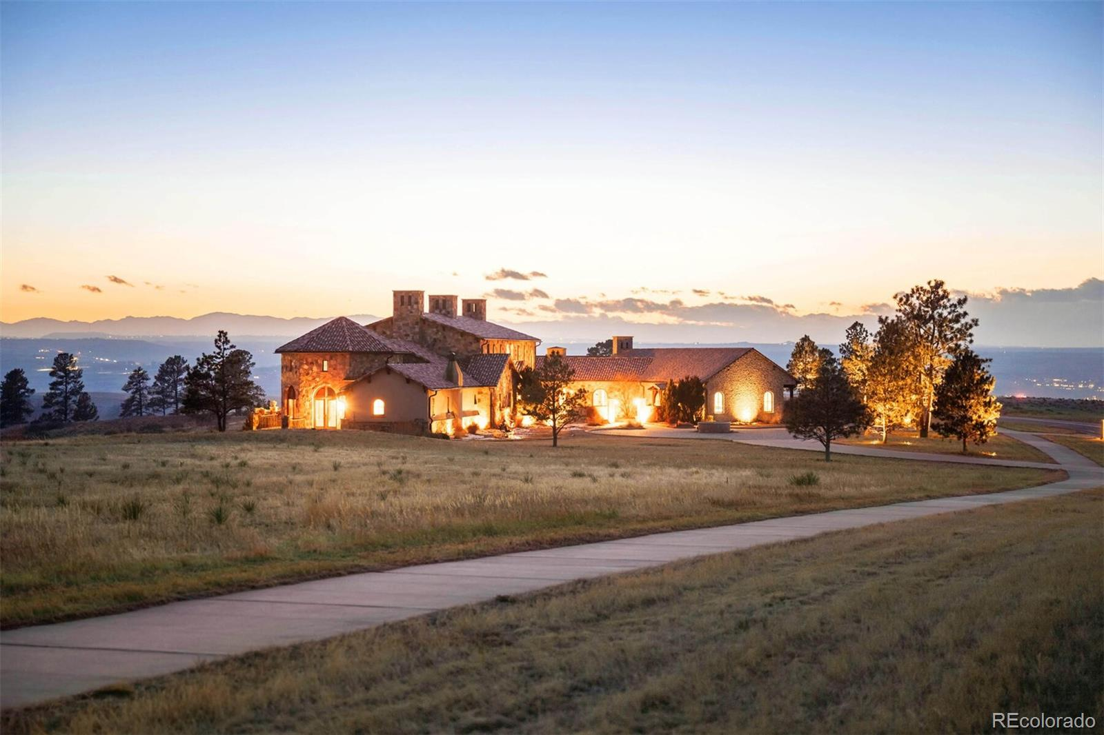 An opportunity to own one of the Signature properties in Colorado Golf Club, at over 16,000 finished square feet, with arguably the most European flair in the Club. The exterior finishes are reminiscent of the estates in Italy. The foyer of this grand estate is similar to entering a resort with art galleries, libraries and custom pieces that are easy to name drop when you realize you are seeing custom work installed by craftsman throughout the home. Names like architect, Don Ruggles, and custom details from John Richards, Guy Chaddick, +more all selected by the keen eye of Rob Osgard, Interior Designer with Howard Lorton who worked with the owner to make this dream come true. As one of the initial building sites in the Colorado Golf Club, this home boasts the views people dream of having in Colorado. From the Rocky Mountain National Park to Pike's Peak, these sunsets and elevated views are truly one of a kind. It includes an elevated balcony space, with outdoor fireplace, hot tub, entertainment area, kitchenette and views that truly stretch the imagination.  Keep in mind, the Colorado Golf Club is a favorite warm up for PGA members, and you are overlooking the 1st Fairway. The floor plan is perfectly laid out with 6 bedrooms and 10 bathrooms, two custom designed offices, an oversized 4 car garage, an area for multi-generational living and a guest house with 2 bedrooms, beautifully appointed kitchen and living room/dining room, this estate really has provided for all the needs of the modern consumer.  Every room has something special. And, for those who love to entertain - the courtyards, patios, balconies and fountains make having friends and family over a true joy. The heated courtyard in traditional Tuscan style would be the perfect setting for those summer wine parties – just add your café lighting. A walk-out basement party room with a professional sized marble and mahogany bar, two fireplaces overlooking the golf course and views of Pikes Peak.