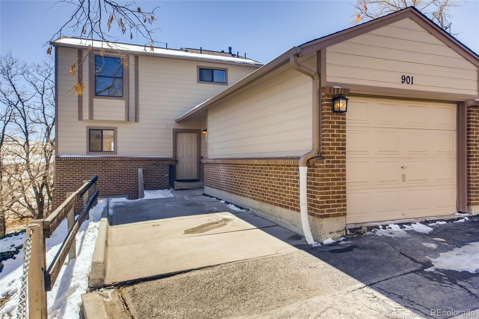 This charming, beautifully remodeled townhome sits at the end of the cul-de-sac, which backs and sides to heavily wooded open space. The area is perfect for the outdoor enthusiast who's looking for that perfect location.  The main level is an ideal size for entertaining, with a completely remodeled kitchen and dining room that extends to the living room with newly refinished wood flooring and of course, it wouldn't be complete without the coziness of a gas fireplace.  Also on the main floor there is a bedroom, full bath, a large laundry-mud room coming in from the one-car garage and a deck off the living room with mountain views!  On the second floor you have a master suite with a spacious 3/4 bathroom with a new double vanity, sinks, lighting and new flooring. There is also a third bedroom and full bath.  As a  great added value, you still have a full 90% newly remodeled walk-out basement with a fourth bedroom, family room, gas stove,  utility room and a designated area for a full or 3/4 bath in the future.  The entire home has new paint, new carpet, new lighting fixtures, new electrical outlets, switches, appliances, new cabinets, quartz counter tops and all new undermount sinks and faucets.  Kinney Run community is an easy walk or bike ride to Colorado School of Mines and historic downtown Golden. If you like the cozy mountain feel with the convenience of great restaurants, shopping, biking/hiking trails, then this home may be perfect for you.  Call Bobbie or Andy for your personalized tour!