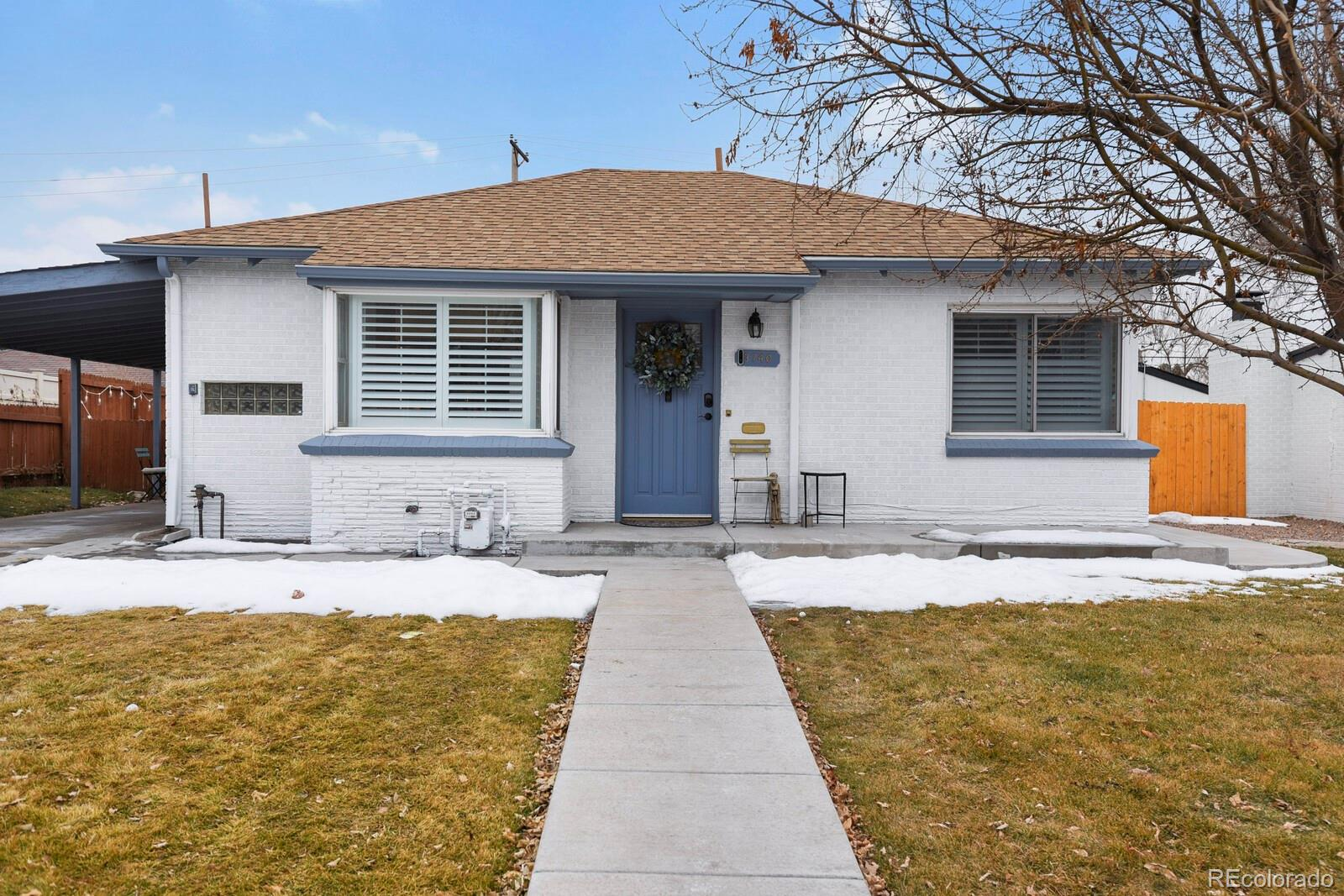 Beautifully updated house in Skyland (North City Park), situated across from the historic Clayton Campus and minutes from the best of what Denver has to offer: nightlife in LoDo, art galleries in RiNo, restaurants and shopping in Cherry Creek, and walking/biking distance to City Park, the Denver Zoo, and the Denver Museum of Nature and Science.   Originally built in 1951, this home retains some mid-century vintage features, including the original metal mail slot, hardwood floors, coved ceiling, arched entryway to the bedrooms, plaster walls, and milk delivery door.   Outside, enjoy a beautifully landscaped and fenced oversized yard with a custom brick patio, five irrigated garden plots, and newer poured concrete porch. The exterior boasts new gutters, new paint, automatic sprinklers in the front and back yards, a storage shed, and carport with a side entrance to the house. Inside, enjoy the views through oversized windows with new plantation shutters while granite countertops, recessed lights, and a finished basement with new gas line, two bedrooms, large remodeled bathroom, family room, and laundry room with Samsung appliances complete the package.