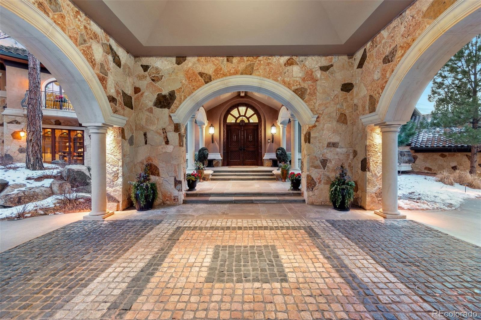 From the moment you arrive at Villa Toscana's grand porte-cochere entry and step through the hand-carved front doors, the attention to detail and artisan craftmanship is evident. This expansive home is truly a work of art created from hand-carved wood, solid crafted stone, Italian marbles, magnificent painted and plastered domes, large arched solid doors, Brazilian ebony flooring, and forged metal. Architect Sears Barrett designed the home straddling the property's long ridge to maximize passive solar efficiency. The East Wing is entertainment and dining. The West Wing is the private wing with bedrooms, library and offices. The wings are connected via two groin vaulted galleries. The main level features the kitchen, hearth room, living room, dining room, library-office, and master suite.  The lower level full walkout features the theatre, bar, wine cellar and recreation room. The lower level guest wing includes three bedrooms and a mirrored exercise room with lockers and steam shower. The Villa's eclectic Italian design is accented with Moroccan, Egyptian, and Asian influences. Extensive Green Features include non-toxic building materials. The Villa features a large fully equipped wraparound bar and temp-controlled wine cellar.  The theater has a magnificent carved Egyptian door, custom tiered seating, a performance stage with adjoining dressing room, remote control projector, lighting, audio and stage curtains.  The main floor master suite has a private sitting room and balcony/spiral staircase, large luxurious master bath and steam shower. Every corner of the Villa has custom designed trim work and finishes. Each level of the Villa provides walkout exit to grade in case of fire and the upstairs bedroom closets serve as panic rooms with solid doors and hard-wired telephones.  Soak in the property's views, sunsets, nature and wildlife on 5,700 sf of outdoor terraces and balconies. FOR MORE INFO & A VIDEO TOUR VISIT www.6eaglepointelane.com.