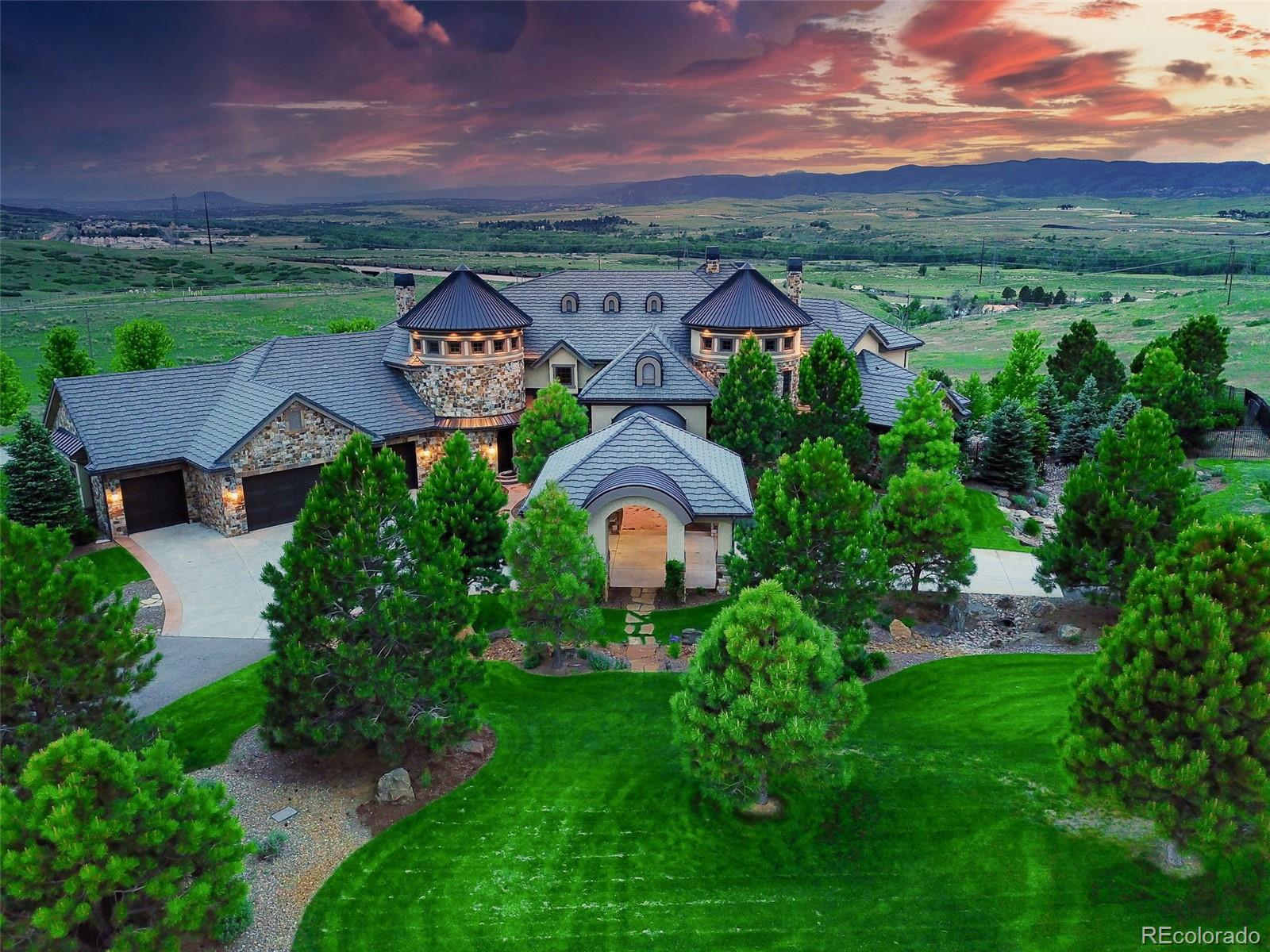 Colorado luxury lifestyle is personified in this exquisite estate on 41.5 acres of unobstructed views of nearby mountains. The 13,609 of finished SqFt boasts 11 bedrooms, most w/ private bathrooms & private balconies/patios. A true gourmet/entertainers kitchen is graced w/ a Wolf gas range, 2 Sub-Zero refrigerators, 2 Asco dishwashers, and a Butlers pantry that includes another refrigerator & dishwasher and leads to a large, formal dining area. The massive kitchen island flows to a large breakfast area, then on to a magnificent 2 story great room, focusing on a massive stone fireplace and a full wet bar to host gatherings w/ family and friends. The primary bedroom suite, private to the west wing, includes fireplace, balcony, 5 piece bath w/ Jacuzzi air tub, heated floors, large-walk in closets and is accessed by stair or elevator through the mater suite sitting room w/ its own wet bar and dishwasher. Features include 2 elevators, a 2 story formal office, 5 fireplaces, and conveyor belt to transport groceries from the garage to kitchen! Guests will love the 2 bed/2 bath mother-in-law suite w/ full kitchen, fireplace, balcony, laundry room, all accessed by its own private entry and elevator. The walkout basement w/ wet bar, workout room, gaming area (extra ventilation), 2 bedrooms w/ private baths and a theater room create perfect entertaining space! An auto lover's dream, the home comes w/ an 8 car attached pass through garage, PLUS a detached 8 car pass through garage with 1,161 of finished SqFt (incl in total) above (rec rm w/ pool table, kitchenette). The property hosts a full size illuminated basketball/tennis court, lush landscaping w/ water feature, fire pit, and 41.5 sprawling acres to enjoy the freedom to ride horses or ATVs & is zoned for agricultural use. This home includes 5 HVAC systems, 4 tankless water heaters, electronic entry gate, heated drive & security system. Rural but minutes to light rail, short drive to downtown Denver. Agent related to Seller