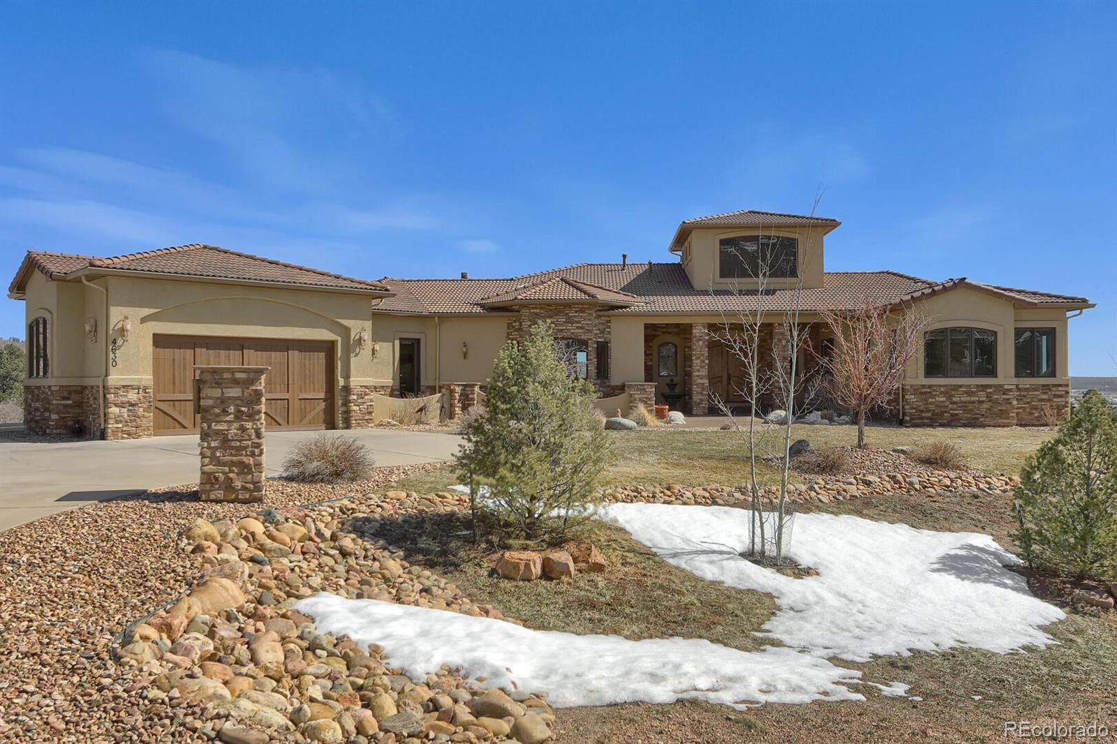 Beautiful Rancher on a Walk Out located on 2.5 acres! Incredible Location! 5 Bed, 7 Bath, 4 Car Garage! Large Wrap Around Deck with amazing views! Gourmet kitchen with upgrade appliances, island, granite countertops, & large pantry. Breakfast Nook/ Sitting area off kitchen with a fireplace! Large Laundry area with an additional 1/2 bath. Large Open Great Room with Fire Place and more Views! Separate Dining area! Main Level Master with large Master Bath and lots of closet space with additional washer/dryer hook up! Large lower level Family Room with Wet Bar and Fire Place and a Walk Out to a Patio & Hot Tub! 5 large bedrooms including Master on Main with an additional bedroom on the main level.(Could be used for an office or bedroom.) Custom Built-In Cabinets! Large area for Dog Run (wrought iron fencing off lower level.) 34 X 15 Court Yard Area! Large additional storage room in basement. Speakers for sonos music in the kitchen,family room,master bedroom,master bath,office,basement family room. Central Vac. Come enjoy the Monument lifestyle located in the foothills of Colorado Springs/Monument with access to miles and miles of hiking trails right out your back door! (See Interactive Floor Plan on Virtural Tour for Floor Plan and Room Sizes!!)