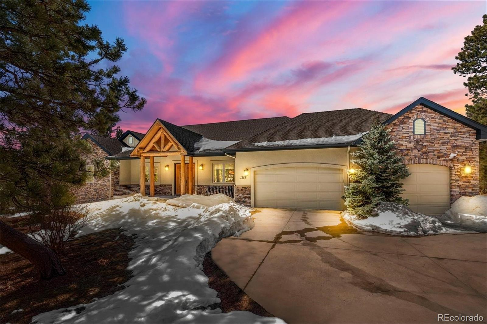 Expansive custom rancher with almost 5,000 square feet, phenomenal Pikes Peak and mountain views on 3.31 acres of matures pines with tons of privacy. Close in location on a quiet cul-de-sac west of Highway 83 in the desirable Bent Tree community. Welcoming entry with a covered front porch and a double front door entry. Both levels of the home have 10ft ceilings. Upon entering the home you enter into a large, bright foyer w/ slate tile open to the great room. The great room is spacious with large windows to take in the fantastic mountain views, custom built-ins and a gas fireplace with slate surround. Large 22x11 composite back deck with patio furniture included. Well appointed kitchen with high end cabinetry, granite counters, under cabinet lighting, a double oven, an abundance of cabinetry, hardwood floors, kitchen eating nook and a gas cook-top. Formal dining w/ crown molding and tons of space which would accommodate an 8 person dining room table. Spacious master suite with a walk-out to a private composite deck, walk-in closet w/ built-ins, tons of natural light and a 5 piece bath. Main level office w/ french doors and custom built-ins and desk are included. Large main level mud room/laundry room with storage, seating and a utility sink. Finished walk-out lower level with 3 bedrooms, 2 baths, a game area and the family room w/ a wet bar and fireplace which walks out to the large lower back patio. Secondary suite bedroom in the lower level w/ large walk-in and a private bath. Central air conditioning. The home has been exceptionally maintained and is in great condition. Low maintenance stucco and stone exterior w/ composite decks. Beautiful landscaping w/ a chipping green area. All paved roads to property with a paved driveway. All bedrooms have walk-in closets. Attached, finished and insulated oversized 3 car garage. Close to the amenities of Northgate and Monument w/ great access to I-25, Highway 83 and the Air Force Academy. Award winning School District 38.