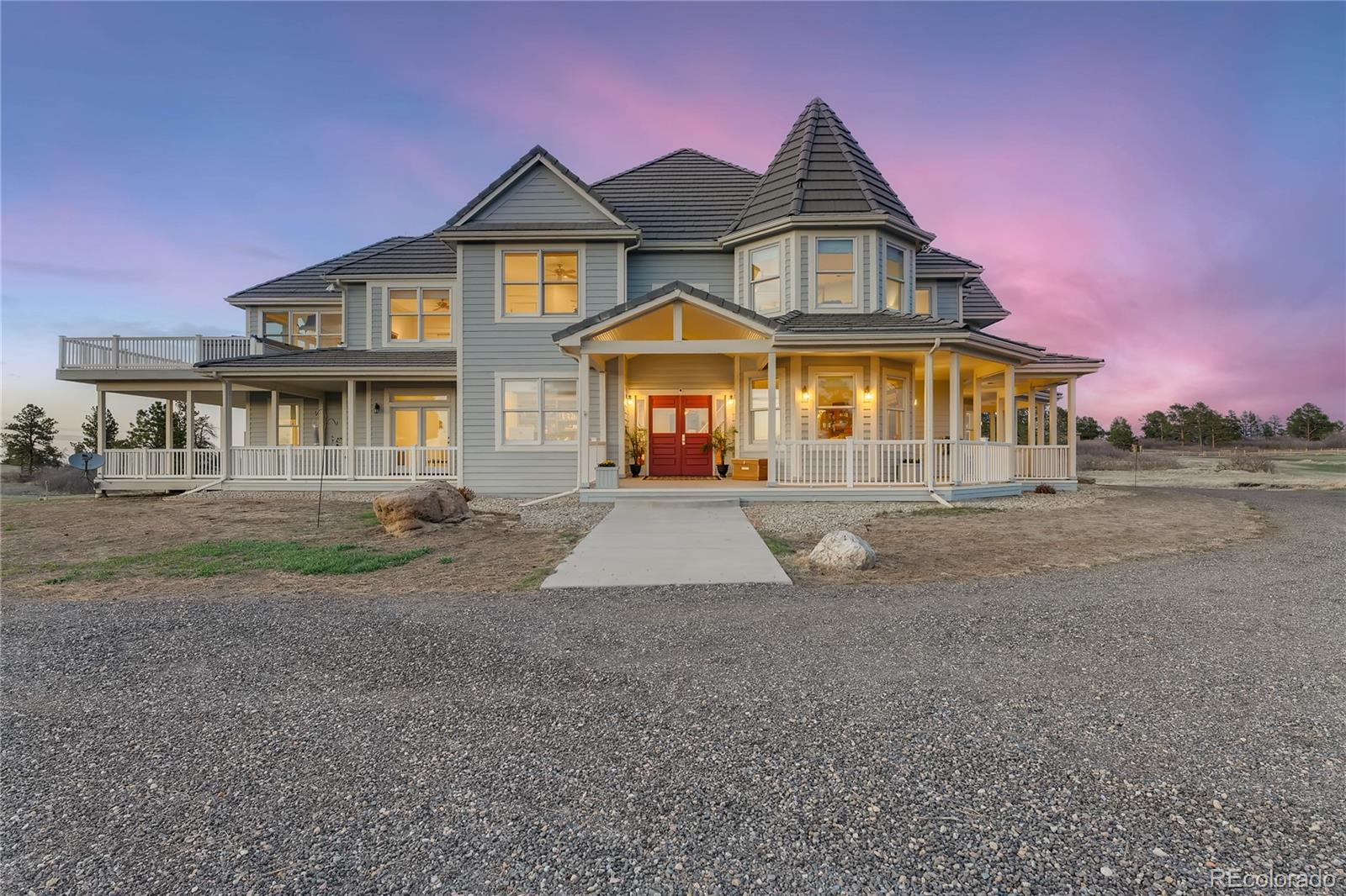 """PREMIER STORYBOOK VICTORIAN BEAUTY! THIS SPRAWLING FULLY FENCED & GATED COLORADO EQUESTRIAN ESTATE WILL TAKE YOUR BREATH AWAY! VIEWS AS FAR AS THE EYE CAN SEE! UNPARALLELED LOCATION & SETTING! ONE OF A KIND PRISTINE 35 ACRE LOT! EXTREME PRIVACY! **DIRECTLY BORDERING CASTLEWOOD CANYON STATEPARK & OPENSPACE-MILES OF HIKING TRAILS** GORGEOUS UNOBSTRUCTED PIKES PEAK & MOUNTAIN VIEWS *ROCK OUTCROPS *PRIVATE DUCKPOND *STUNNING GENTLY ROLLING GRASS HILLS & WILDFLOWERS*FULLY USABLE LOT-PERFECT FOR ENDLESS GALLOPING & ARENA! Constructed w/quality craftsmanship! Distinctive rustic elegance*Designer touches*Handsome woodwork*Soaring vaults*Gleaming knottypine woodfloors*Custom Upgraded lighting & paint*2 familyrooms w/fireplaces*Elegant formal dining-IMAGINE HOSTING HOLIDAYS! Executive office w/french doors &built-ins* Chef's gourmet kitchen w/granite, upgraded cabs, HIGH-END stainless appliances-OPEN CONCEPT directly to cheery breakfast nook and family room* Large master w/fireplace & en-suite 5p bath. Endless room options- family rooms/playroom/gyms/offices. Large bedrooms w/bath access. HUGE WINDOWS ENCASE PICTURESQUE NATURAL VIEWS LIKE ARTWORK! Fin basement*3car att garage. Horses treated to fenced grass pastures, spending days relaxing on graceful meadows. Charming (easily converted) Large barn w/water*electricity & fenced runs- currently set up as 2stall w/run & 2tack rooms & HUGE HEATED STUDIO/OFFICE* Large loft*Loafing shed. Framed Pikes Peak view out barn door. Community bridle path. SOAK IN HOTTUB-OVERLOOK WILDLIFE ROAMING, DUCKS IN POND, ORANGE/PINK SUNSETS & ROMANTIC STAR-LIT NIGHTS! Jog your private 1mile perimeter track. Separate fenced dog yard. Wrap-around deck-perfect for entertaining! Sip morning coffee in serenity of nature & listen to symphony of birds. LUXURY """"EAST RIM RANCH"""" GATED COMMUNITY! COUNTRY OASIS-VERY close to shopping, restaurants, Denver, DIA.BENEFITS=AESTHETICS, COMFORT, LIFESTYLE, PRESTIGE & AMENITIES! VIDEO LINK https://youtu.be/nTbhoMuzVFo"""