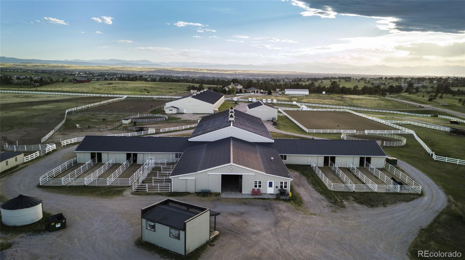 One of a kind!  41 Acres in the heart of Parker Colorado with high income potential! Country living at its finest, 3 mile drive to everything city living provides.  Over 48 thousand square feet of structures including two dustless indoor riding arenas, main barn, multiple tack rooms, 40 + stalls all including automatic heated waterers,  5000sqft. mechanic shop with Hydraulic lifts and living quarters,  pull through Hay barn with storage rooms and loft, two ranch hand living quarters, storage silo, fully fenced and so much more! Open floor plan ranch style home with walkout basement with a year round heated pool in the private back yard.Recording studio, theatre  the list goes one. Amazing mountain views  no other property in Parker compares! Perfectly nestled in the pines, this property is any horse lovers dream come true! Contact Listing Agent for further information and coordinating site visit.