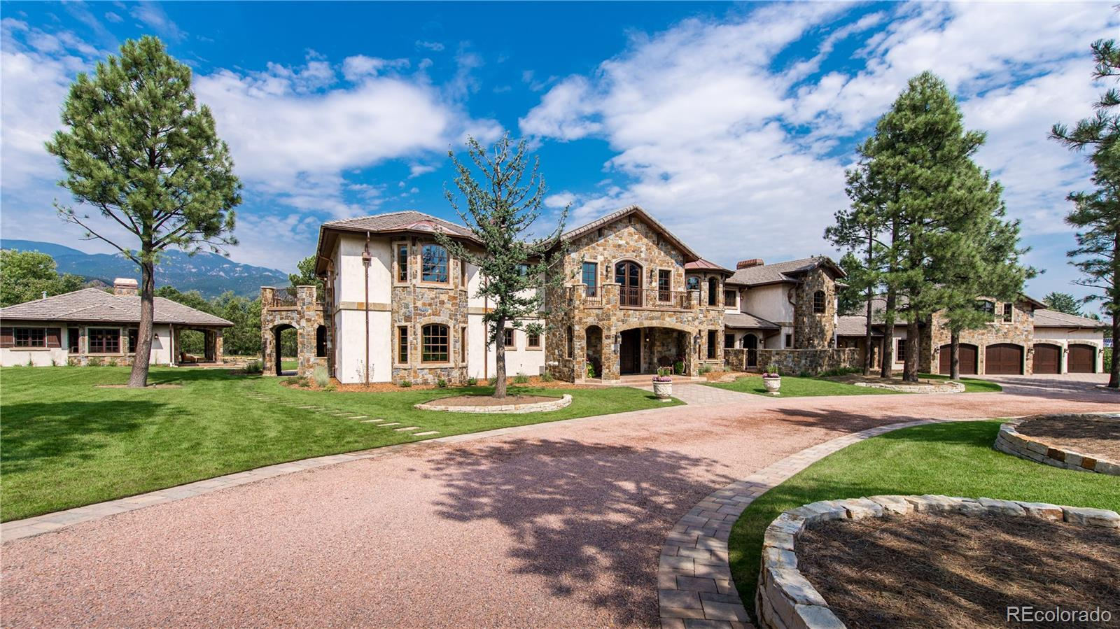 Welcome to this gorgeous family compound!  The most spectacular home in Colorado Springs!  Located within walking distance to the famous 5 Star Broadmoor Hotel, this masterpiece is adjacent to a 20 acre private park.  As you walk through this gorgeous home the attention to detail will astound you. This custom home was lovingly built with materials from around the world:  African Mahogany Doors, Italian travertine flooring, Hand scraped pecan floors, Douglas Fir Beams from Oregon, Hand Carved Travertine Fireplace surrounds from Mexico, Italian Marble flooring, Stone from Montana and Colorado.   From the floor to ceiling windows that greet you when you arrive to the outdoor patios and decks that afford you the majestic mountain views.  The home features 2 story great room, formal dining, cozy family room with access to the outdoor covered patio, a expansive library/study combination with built in's for your treasures and plenty of room for a multi-person office.  5 bedrooms in the main house, fully finished walkout complete with family room, game room, exercise room, bedroom, spa.  The wine cellar will hold your extensive collection with a tasting area you won't want to leave. An above garage apartment/studio is perfect for live in help or additional family member.  The separate guest house provides complete privacy for extended family or guests.  Broadmoor Golf membership available.