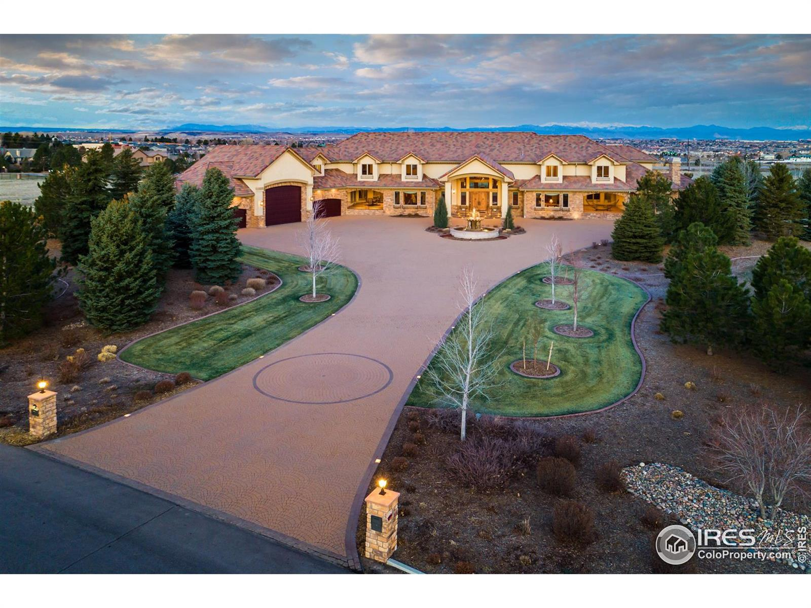 Welcome to this amazing estate located on 5 acres with 8 bedrooms & 12 bathrooms. This custom-built home sprawls across 23,454 square feet with natural light, huge windows & views! A European paver driveway welcomes you into the home with double stairways, intricate attention to detail all through the home & an elevator to take you to each level. From the Geothermal heating & cooling system to the electrostatically painted metalwork, no expense has been spared. The 8 ensuite bedrooms feature two master suites.  Your guests will be impressed with the entertainment options within this home, from the indoor basketball court to the 18-seat movie theater, the game room, the huge basement living space, the 6/9-hole disc golf course, the gym, the Far-infrared cedar-lined sauna, the outdoor hot tub & the multiple outdoor living spaces that highlight Colorado living at its best.  The Grand Centennial Estate is available & ready for you to take the keys & live the life of your dreams.
