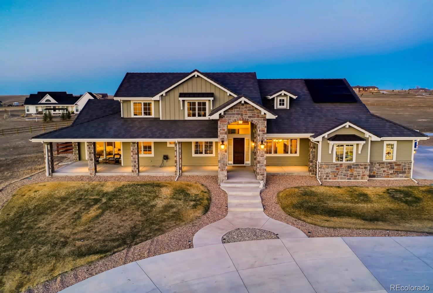 Step inside the epitome of Colorado living! This absolutely gorgeous home is strategically located on 5 full acres, with unobstructed views of the Rocky Mountains, including Pikes Peak. As you enter this breathtaking, one of a kind, custom built residence, you will notice that no detail has been missed. The grand entrance is completely open to the second floor allowing for natural light to flood through this elegant space. As you continue through this open floor plan concept, you cannot help but notice the stone fireplace that stretches from the floor to the ceiling. The decadent fixtures that were carefully chosen are simply cherries on top of this spectacular home. The kitchen carries top of the line appliances such as a Sub Zero refrigerator, and Wolf stove. Not to mention a the Scotsman ice maker & Bosch dishwasher located in the butlers pantry. As you make your way through the rest of the main floor, you will notice 2 guest bedrooms, 3 bathrooms & the exquisite owners retreat. This space was specifically created for ultimate comfort! The fireplace will keep you cozy on cold snowy days & the heated bathroom floors will insure your toes stay equally as toasty. That is not even the best part, the owners retreat closet was crafted for royalty! It features display shelves and space for both partners. The second floor houses two additional bedrooms and baths, to go along with another washer & dryer. As you make your way to the basement, be prepared to be awed. This areas comes finished with an extensive storage area, theater room, full bar, wine cellar, safe room & direct stairwell to the garage. This space is sure to be one of your favorites! As you make your way outside, you will be blown away by the amount of garage space comfortably accommodating 4 cars. The outbuilding is extraordinary with limitless possibilities, including a car lift. The solar panels are paid in full! A custom home such as this does not come along often. Welcome to your Colorado Dream!