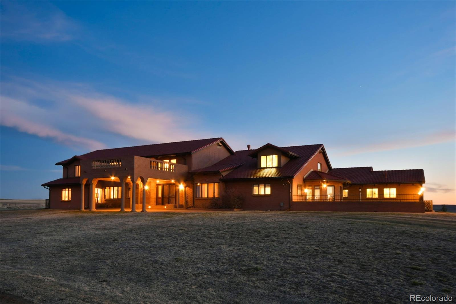 The estate you've been looking for w/ a grand main home, smaller second residence, privacy, & good pastures on almost 2000 acres of prime Colorado ranching property*Sitting on the highest point of the property, you're immediately drawn to the architecture & grandeur of this custom built estate*This home is built solid & all the little details are there*Just some of the highlights are: An indoor pool; elevator; an 8 column porte-cochere entry; curved staircase; 17' ceilings in the great room w/floor to ceiling windows to watch the amazing sunsets & mountain views; exquisite oak cabinets, built-ins, & crown molding throughout the home made from oak milled on the property; 8' wood paneled sliding doors entering the great room; a stunning wood burning fireplace w/ 6' high mantle; a loft overlooking the great room*Truly an entertainers dream- a wet bar area, an elegant spacious formal dining room, a kitchen which boasts double ovens, a 6-burner stove, 2 pantries, eating area & an additional breakfast nook w/beamed ceilings*Several private court yards, a green house & separate fenced garden area*Large bedrooms w/private baths & walk-in closets*A soundproof bedroom in the massive finished basement*Mud room w/hat & boot racks*Laundry room w/utility sink, cabinets & built in ironing board*An oversized 4 car attached finished garage w/4 dog kennels, dog washing station, & 2 gas heaters*Sitting on 1,966.84 of fenced pasture, this land can be used in a multitude of ways*Most recently used as a successful cattle ranch*Enjoy hunting deer, antelope, & game birds on the property as well*Boasting 6 wells throughout the ranch for watering livestock*The original farm house built in 1943 remains on the property & is currently being rented out*Several additional outbuildings included-another 4 car garage, tool sheds, loafing sheds & piped corrals*This is a beautiful property situated on rolling hills & grasslands* Must see in person to appreciate all the custom details.