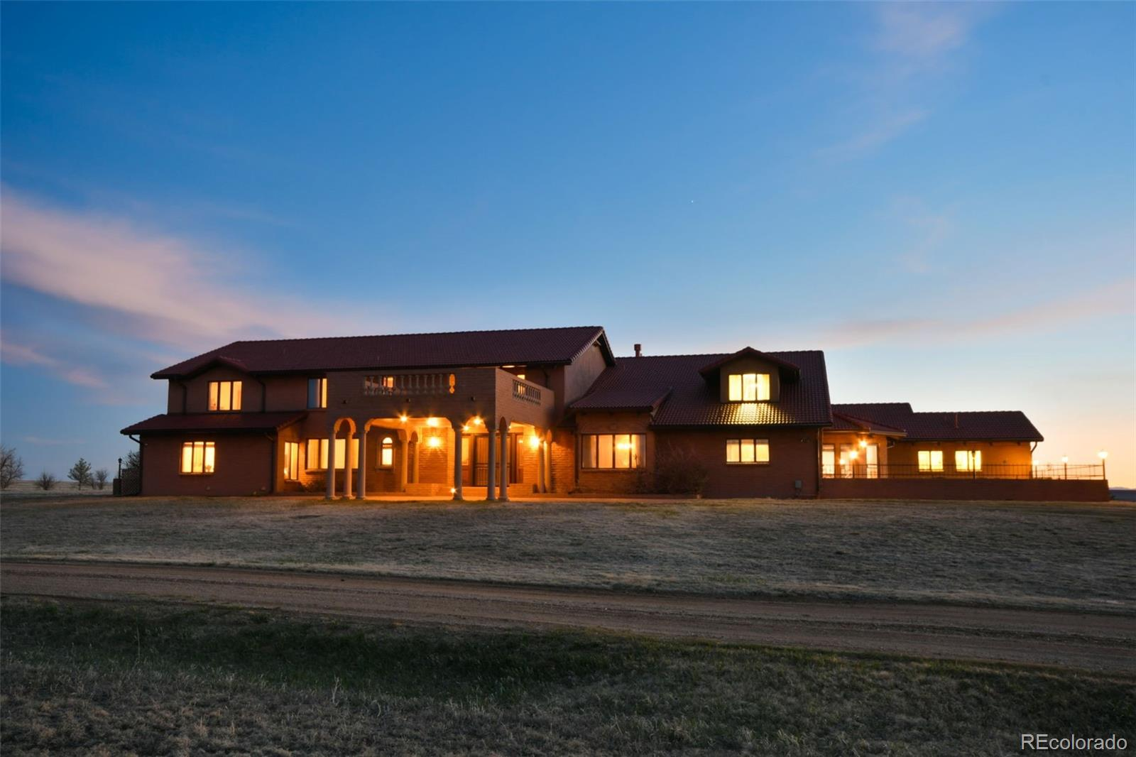 The estate you've been looking for w/ a grand main home, smaller second residence, privacy, & good pastures on 185 acres of prime Colorado ranching property*Sitting on the highest point of the property, you're immediately drawn to the architecture & grandeur of this custom built estate*This home is built solid & all the little details are there*Just some of the highlights are: An indoor pool; elevator; an 8 column porte-cochere entry; curved staircase; 17' ceilings in the great room w/floor to ceiling windows to watch the amazing sunsets & mountain views; exquisite oak cabinets, built-ins, & crown molding throughout the home made from oak milled on the property; 8' wood paneled sliding doors entering the great room; a stunning wood burning fireplace w/ 6' high mantle; a loft overlooking the great room*Truly an entertainers dream- a wet bar area, an elegant spacious formal dining room, a kitchen which boasts double ovens, a 6-burner stove, 2 pantries, eating area & an additional breakfast nook w/beamed ceilings*Several private court yards, a green house & separate fenced garden area*Large bedrooms w/private baths & walk-in closets*A soundproof bedroom in the massive finished basement*Mud room w/hat & boot racks*Laundry room w/utility sink, cabinets & built in ironing board*An oversized 4 car attached finished garage w/4 dog kennels, dog washing station, & 2 gas heaters*Sitting on fenced pasture, this land can be used in a multitude of ways*Most recently used as a successful cattle ranch*Enjoy hunting deer, antelope, & game birds on the property as well*The original farm house built in 1943 remains on the property & is currently being rented out*Several additional outbuildings included-another 4 car garage, tool sheds, loafing sheds & piped corrals*This is a beautiful property situated on rolling hills & grasslands* Must see in person to appreciate all the custom details.