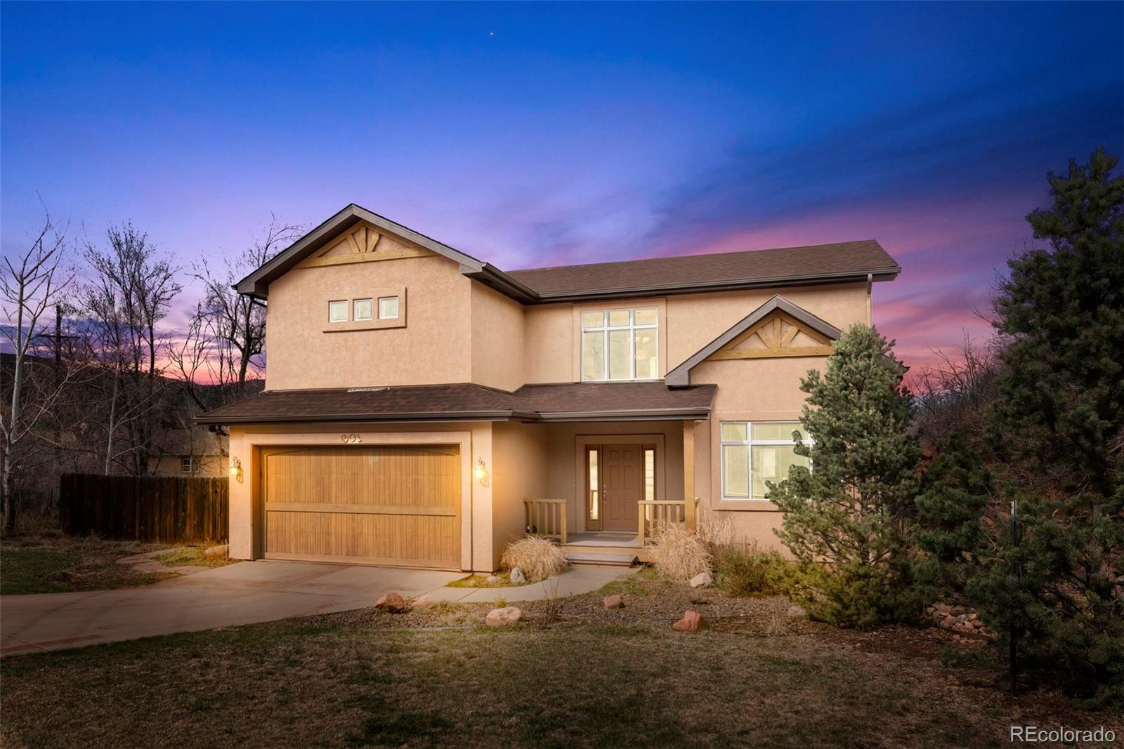 Rare opportunity to own a newer custom home built on over a half acre with beautiful landscaping, views of Garden of the Gods and the mountains in sought after Manitou Springs! All hardwood and tile floors throughout, central air conditioning. Gorgeous open concept kitchen with cherry shaker cabinetry, recessed lighting, pantry, island, slab granite counters, hardwood floors, breakfast bar, gas cook-top and wall oven. Expansive great room with custom cherry built-ins, a gas fireplace, large windows with great views and a walk-out to one of the outdoor composite decks. The home features two suites with private baths - one on the upper floor and one on the main level. Beautiful master suite with sitting area, hardwood floors, walk-in closet, 5 -piece bath, double sided gas fireplace, gorgeous views and walk-out to a private veranda with Garden of the Gods views. The master bath is spacious with a large jetted tub, double vanity with granite counters, travertine tile and over-sized shower. Large upstairs loft perfect for a second family room/game area. Main level laundry with tons of built-in storage and utility sink. Ample outdoor entertaining space surrounded by beautiful landscape. Composite wraparound deck with gas fireplace, private master deck and front porch. Low maintenance stucco exterior. Tons of mature trees, bushes and flower on the large private lot. Grand staircase off foyer detailed with oak & slate. Only minutes to Manitou Springs, the community pool, Garden of the Gods, HWY 24, I-25 and downtown Colorado Springs. See this home quickly!