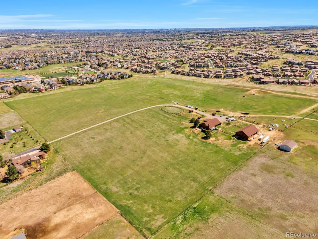 """Awesome parcel of developable land adjacent to Highlands Ranch Backcountry and Chatfield East subdivisions. The views are spectacular, one of a kind,  mountain and city views! Perfect site to develop 15-2.5 Acre lots, suitable for """"high dollar luxury homes"""".  The listed price also includes a 3.7 acre lot in Chatfield East. There are a total of 16 water taps reserved(not paid for but reserved) which can be purchased through Roxborough Water and Sanitation District. Septic systems would need to be installed to handle waste unless a deal can be reached with Centennial Water and Sewer to install sewer lines and purchase taps through that district. There are currently two entrances to the property. There are also two outbuildings on the property. One is a hay barn, and the other contains a large garage workshop area with living space containing 2 bedrooms 3 baths  and a fireplace. Presently zoned agricultural and could make a large estate or horse property in addition to existing property zoning allows for building a main home and guest home."""